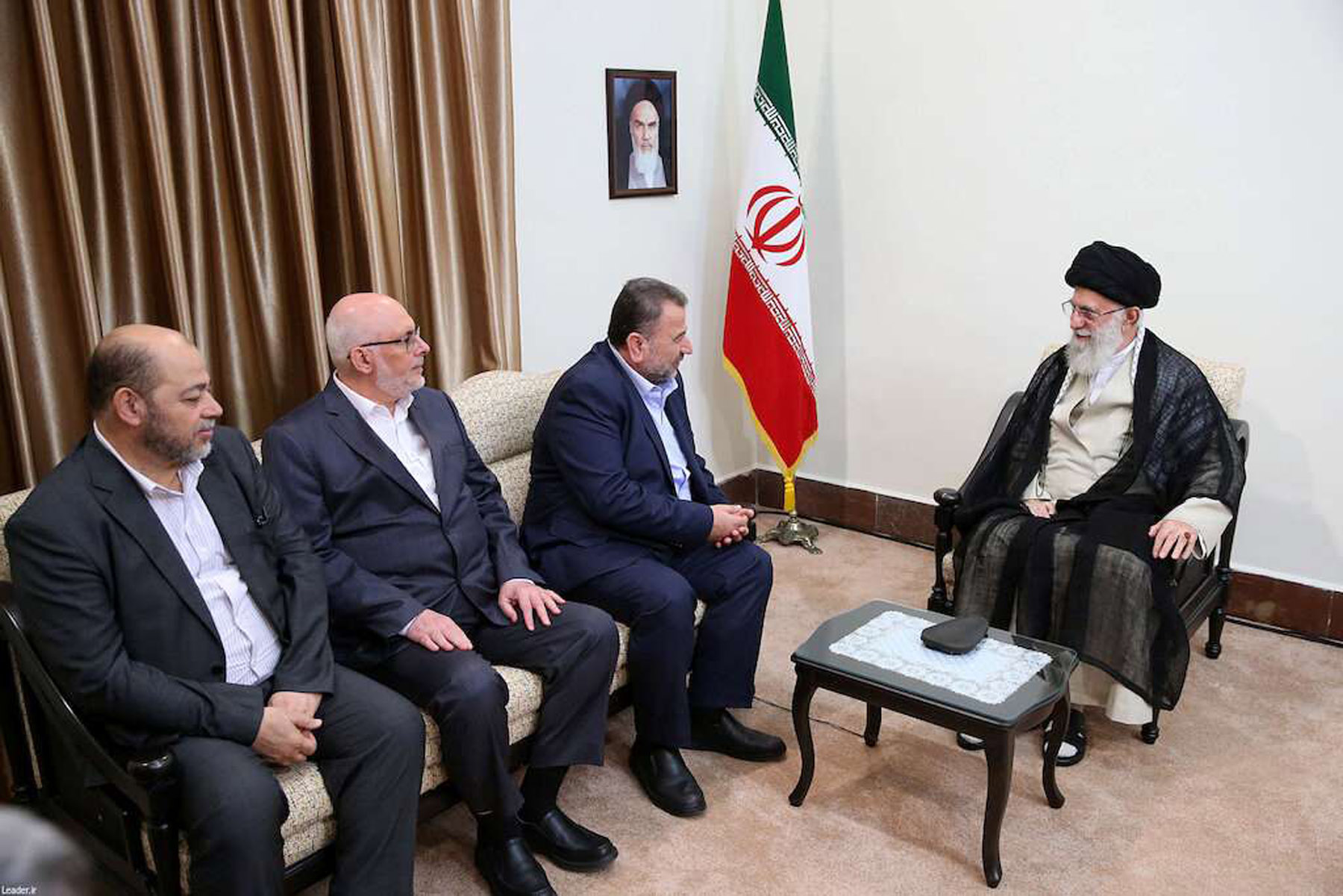 Rising concerns. Iran's Supreme Leader Ayatollah Ali Khamenei (R) meets with Hamas Politburo Deputy Chairman Saleh Arouri (2nd R) and other members of a Hamas delegation in Tehran, July 22.  (Reuters)