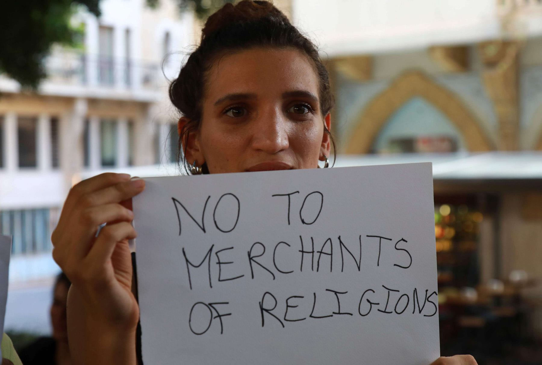 A demonstrator holds a placard during a gathering in support of Lebanese indie band Mashrou' Leila in Beirut, July 29.  (AFP)