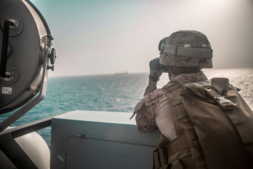 Dangerous waters. US Marine Corps Cpl. Michael Weeks, ranges nearby boats from USS John P. Murtha during a Strait of Hormuz transit, Arabian Sea off Oman, in this picture released by US Navy on July 18, 2019. (Reuters)