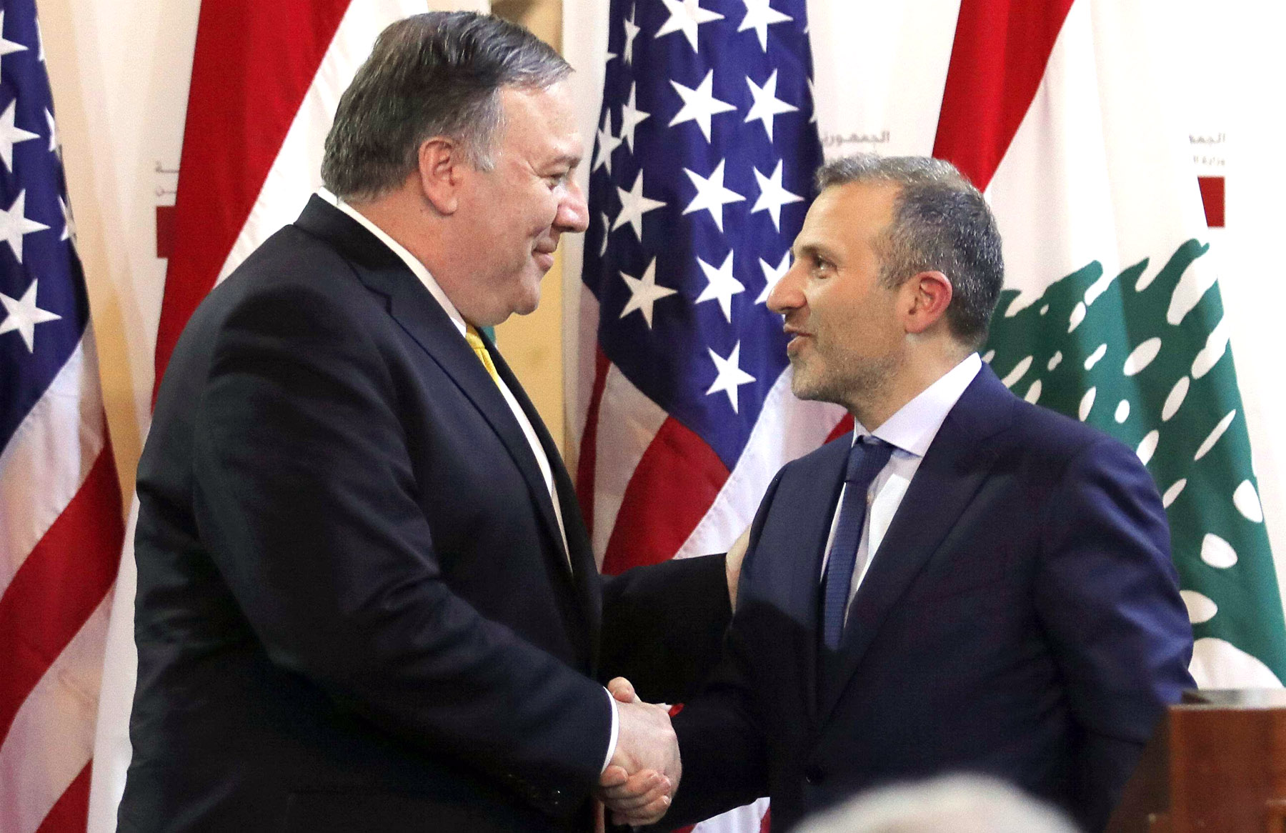 US Secretary of State Mike Pompeo (L) shakes hands with Lebanese Foreign Minister Gebran Bassil after a public statement in Beirut, last March. (AP)