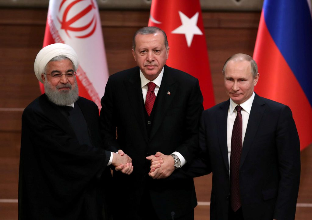 Iranian President Hassan Rohani (L), Turkish President Recep Tayyip Erdogan and Russian President Vladimir Putin attend a news conference after their meeting in Ankara, April 4, 2018. (Reuters)