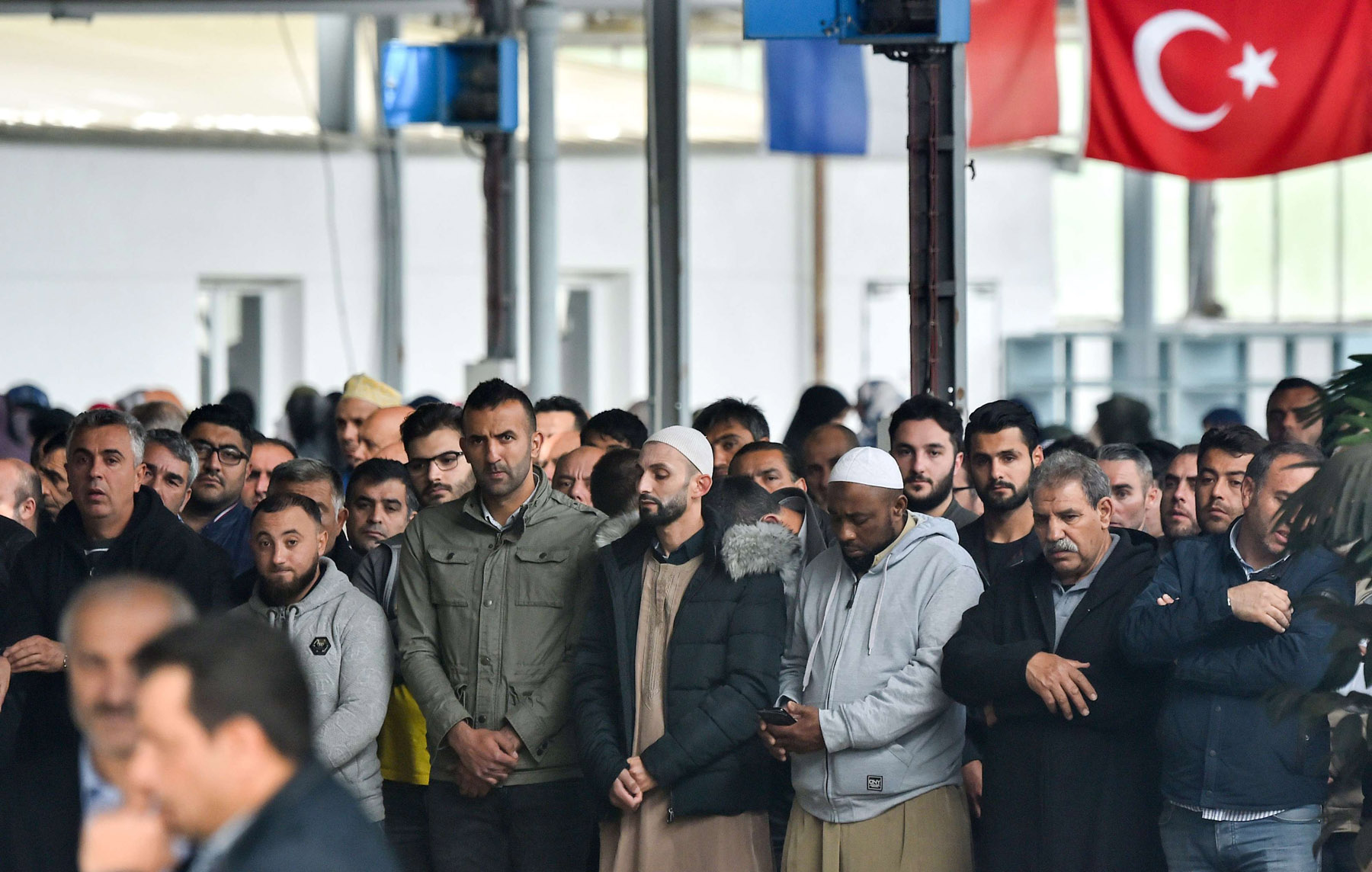 Turkish Muslims pray during a funeral ceremony in Lorient, western France. (AFP)