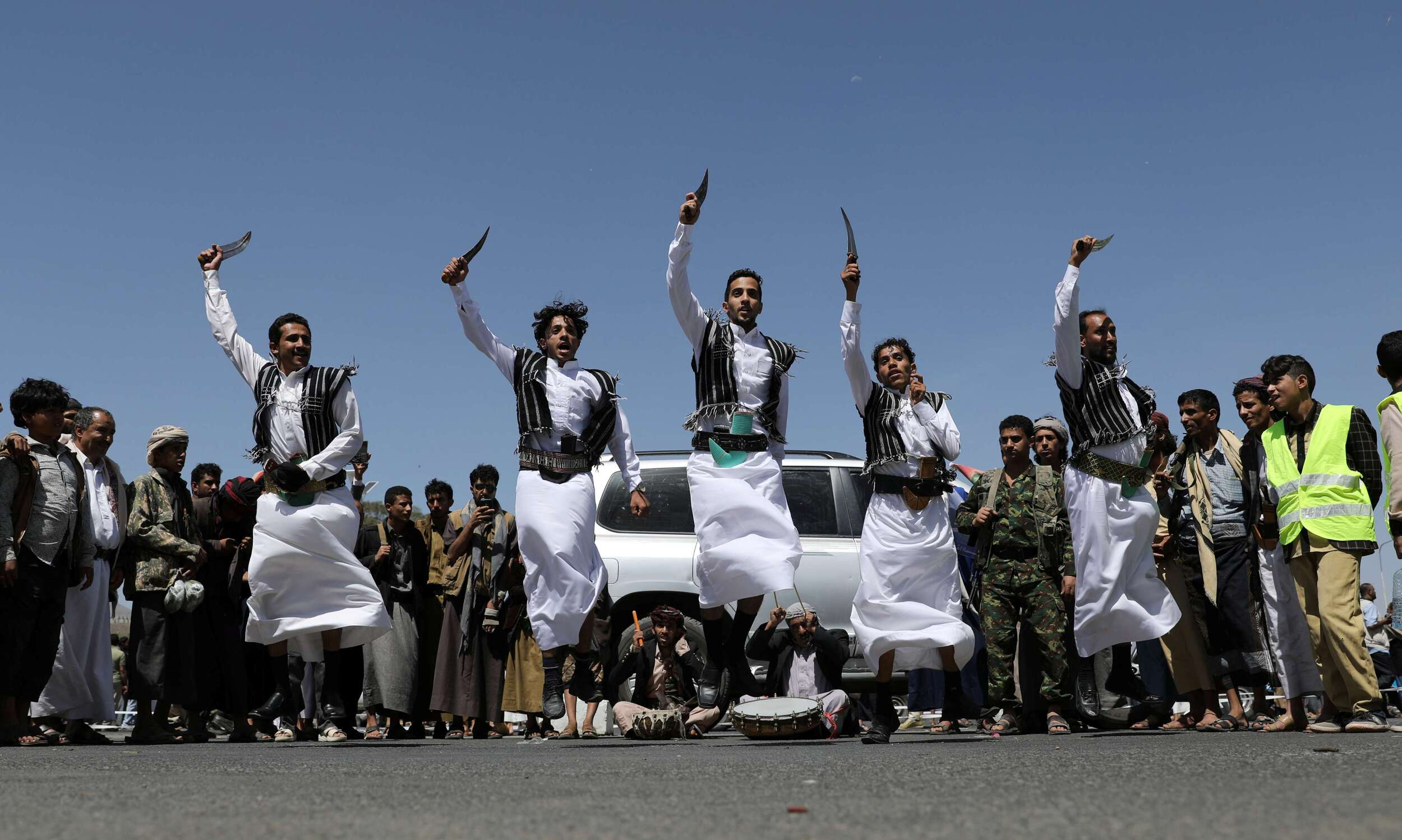Houthi supporters perform the traditional Baraa dance during a ceremony held to collect supplies for Houthi fighters in Sanaa, Yemen September 22, 2019. (Reuters)