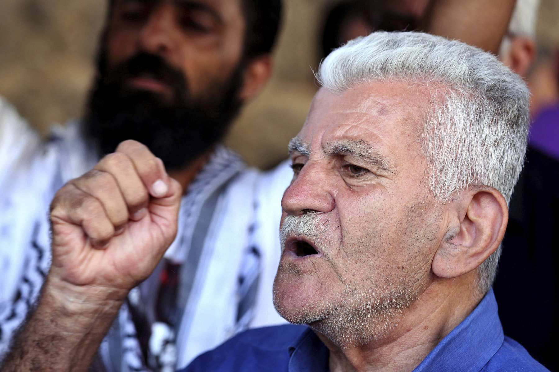 Reopening old wounds. A former inmate of Khiam prison chants slogans during a sit-in near a military court in Beirut where an arrest warrant was issued for Lebanese-American Amer Fakhoury, September 17.  (AP)