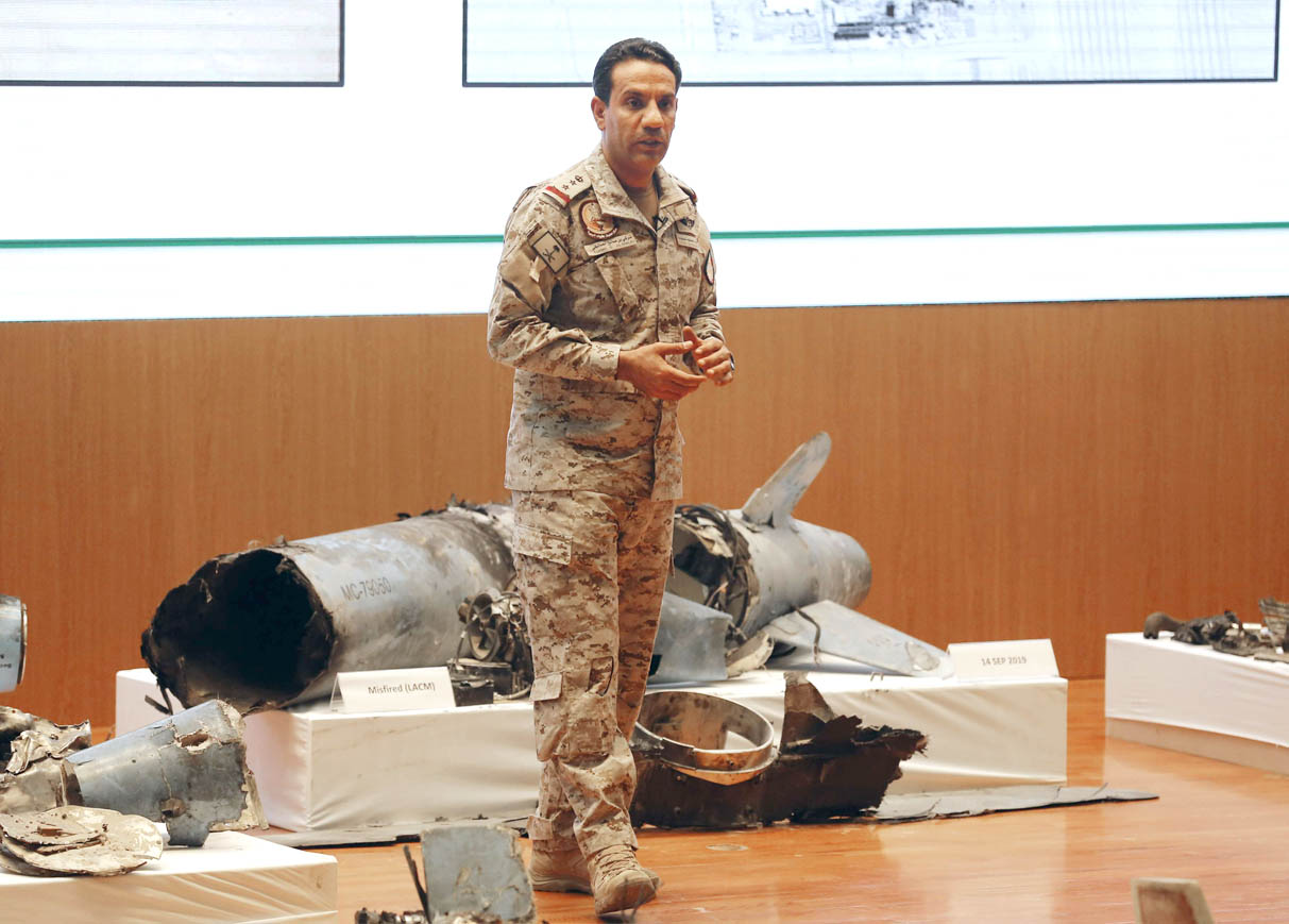Saudi military spokesman Colonel Turki al-Malki displays what he describes as an Iranian cruise missile and drones used in an attack that targeted the heart of Saudi Arabia's oil industry, during a press conference in Riyadh, September 18. (AP)