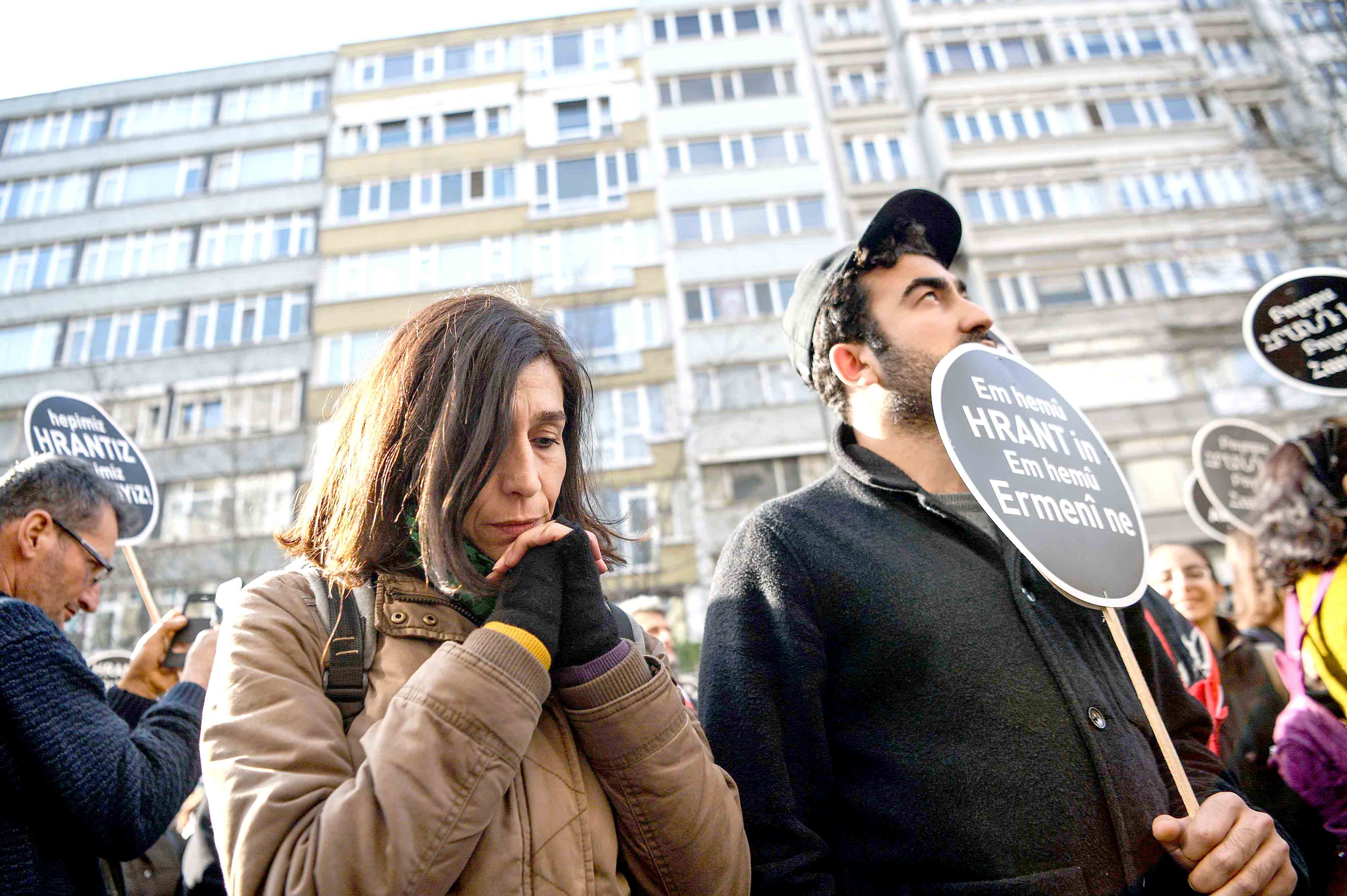 "Healing power of remembrance. People hold placards reading ""Justice for Hrant. We are all Armenian"" in front of the offices of the weekly newspaper Agos in Istanbul, last January.(AFP)"