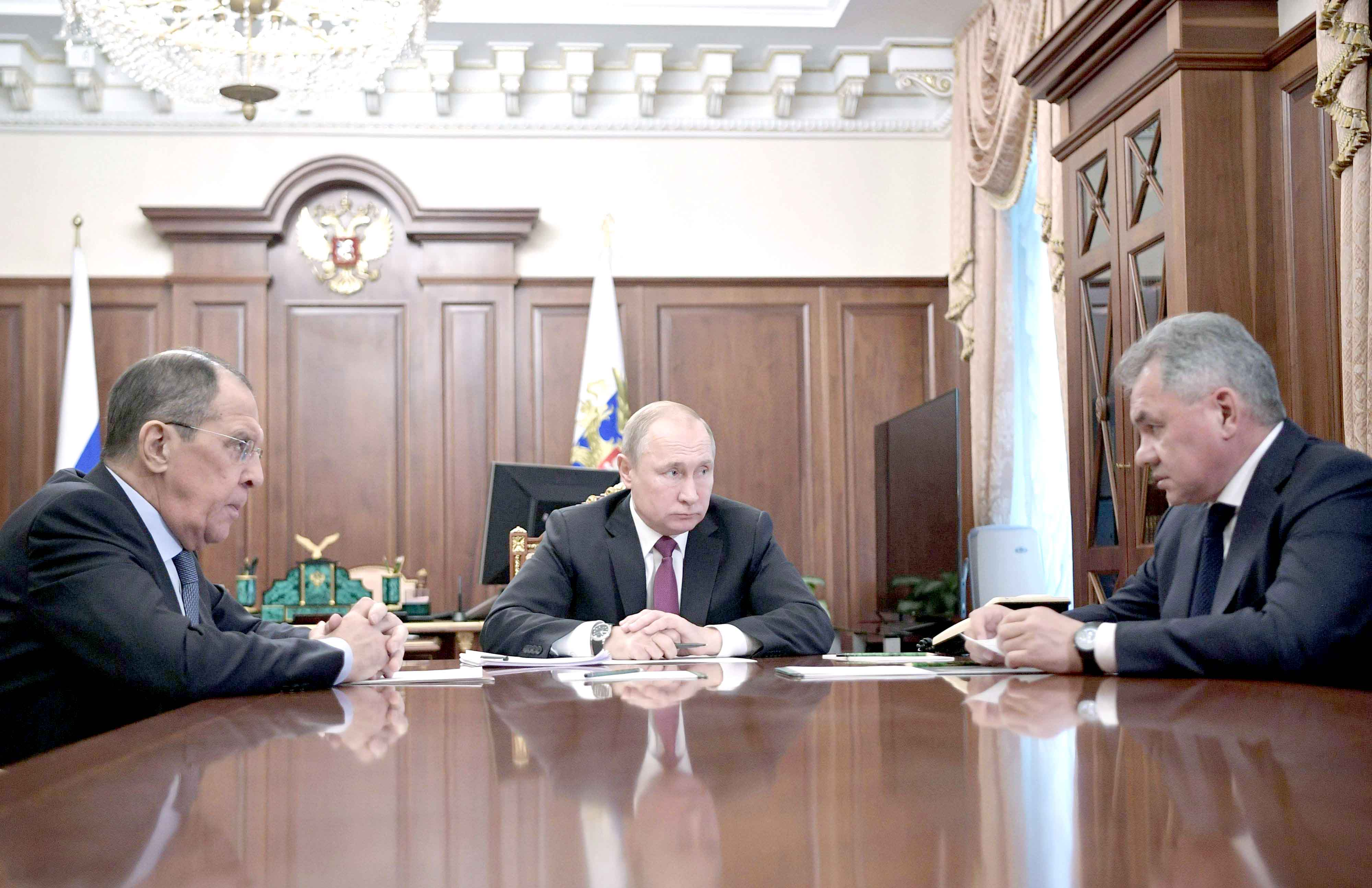 Increasingly assertive. Russian President Vladimir Putin (C) attends a meeting with Russia's Foreign Minister Sergei Lavrov (L) and Defence Minister Sergei Shoigu in Moscow, last February.  (AFP)