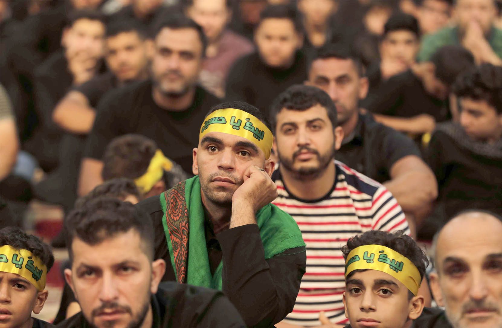 Supporters of the Lebanese Hezbollah movement gather to watch the transmission of a speech by the movement's leader in Beirut's southern suburbs, August 31. (AFP)