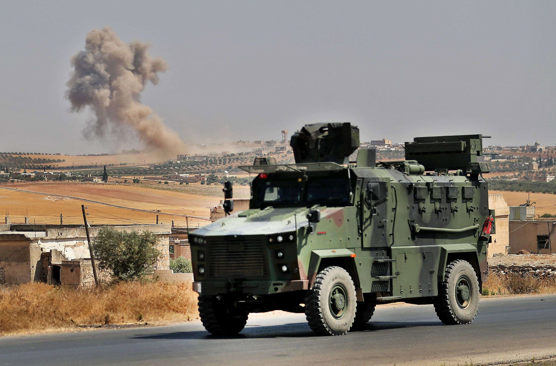 No solution in sight. A Turkish military vehicle is driven near the town of Maer Hatat in northern Syria's Idlib province, August 20.  (AFP)