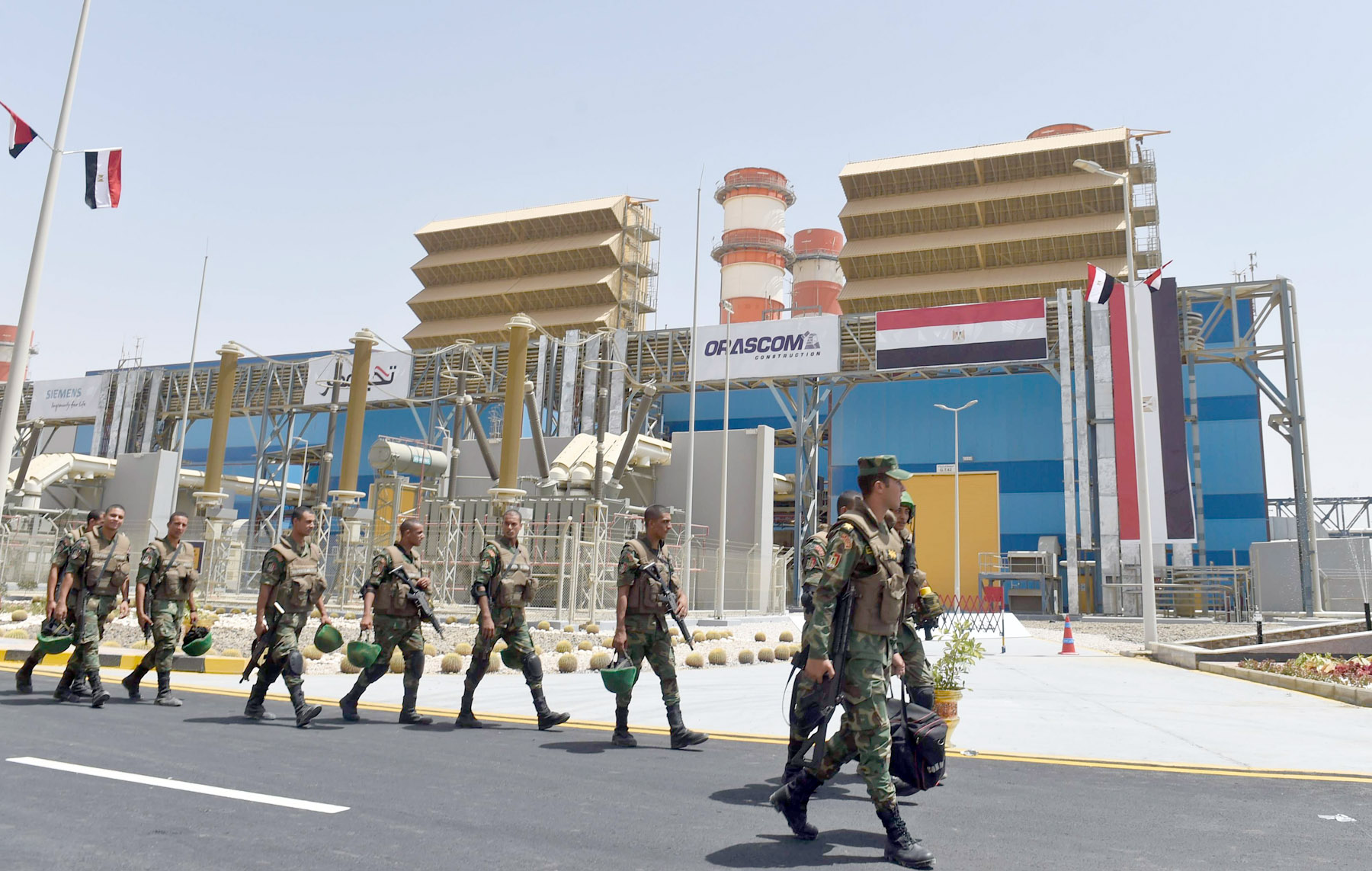 A 2018 file picture shows Egyptian soldiers walking in front of a newly constructed combined-cycle power station on the outskirts of Cairo. (AFP)