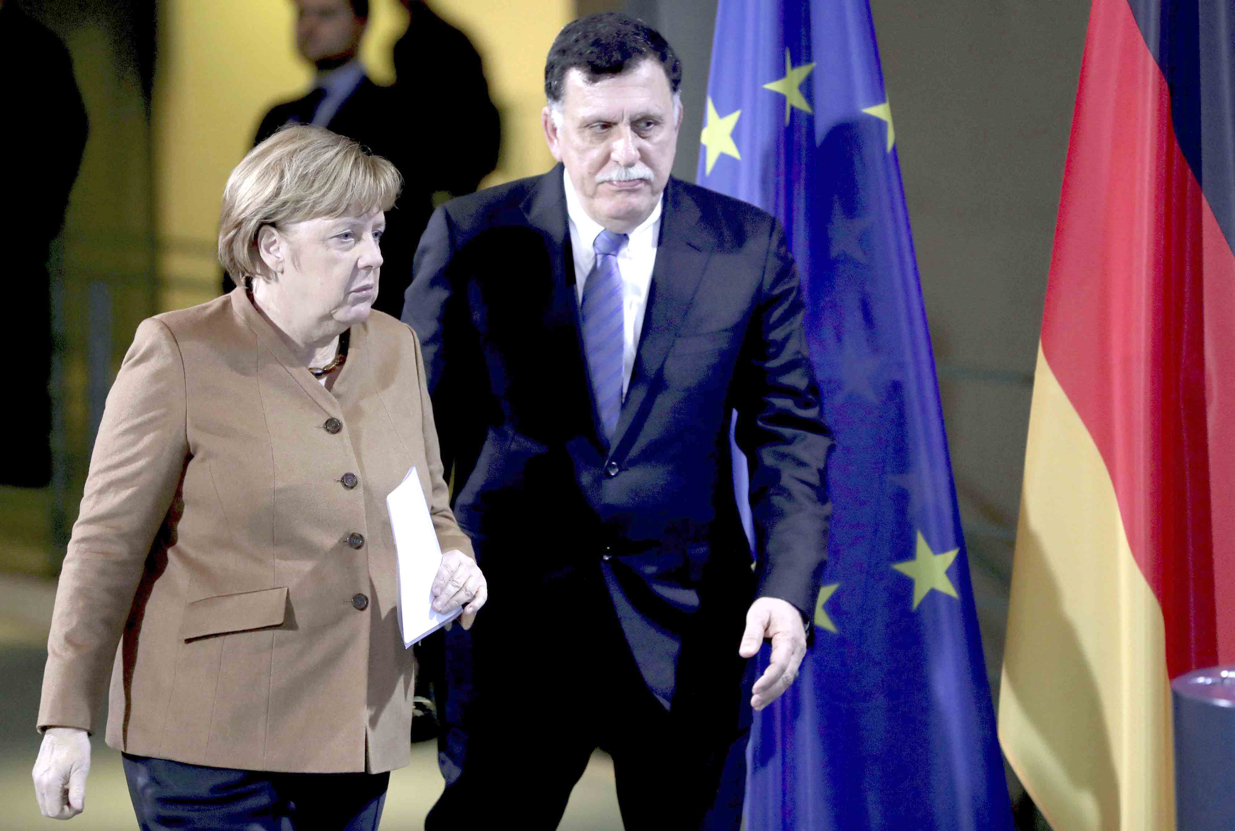 A file picture shows German Chancellor Angela Merkel (L) and Libyan Prime Minister Fayez al-Sarraj arriving for a joint news  conferene in Berlin. (AP)