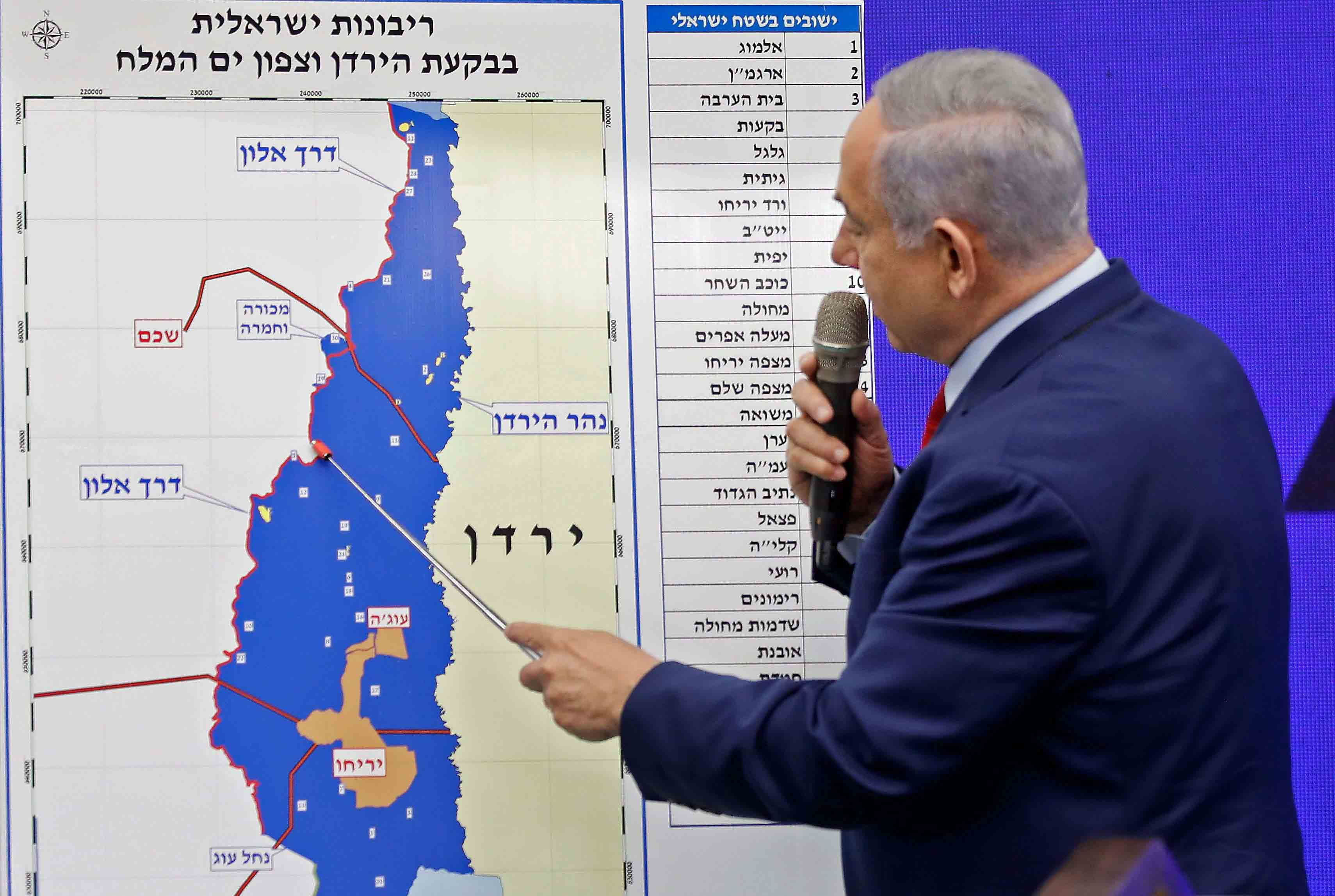 Israeli Prime Minister Binyamin Netanyahu points at a map of the Jordan Valley as he gives a statement in Ramat Gan, near the Israeli coastal city of Tel Aviv, September 10. (AFP)