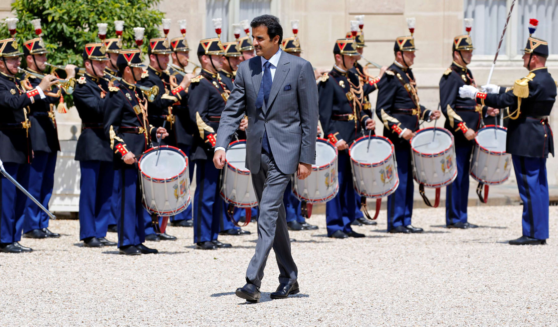 Greeted with fanfare. Qatari Emir Sheikh Tamim bin Hamad al-Thani at the Elysee Palace in Paris, July 6, 2018.   (Reuters)