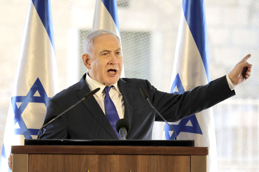 Israeli Prime Minister Binyamin Netanyahu gestures as he speaks during a ceremony in the Israeli-occupied West Bank city of Hebron, September 4. (AP)