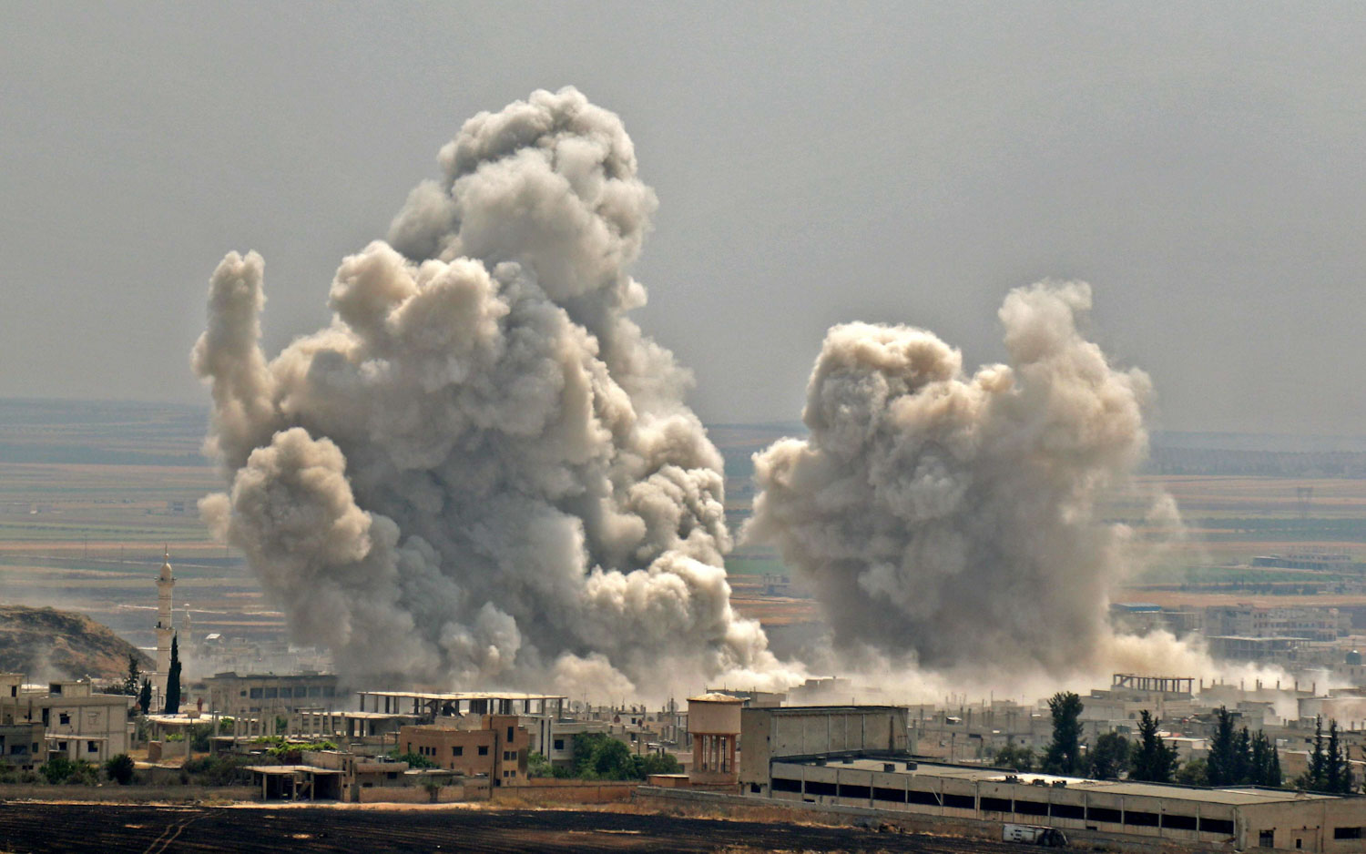 In this file photo taken on June 7, 2019 plumes of smoke rise following reported Syrian government forces' bombardment on the town of Khan Sheikhun in the southern countryside of the jihadist-held Idlib province. (AFP)