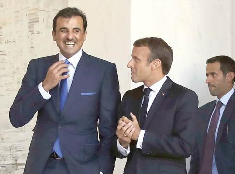 French President Emmanuel Macron (R) and Qatar's Emir Sheikh Tamim bin Hamad al-Thani after their meeting at the Elysee Palace in Paris, September 19. (AP)
