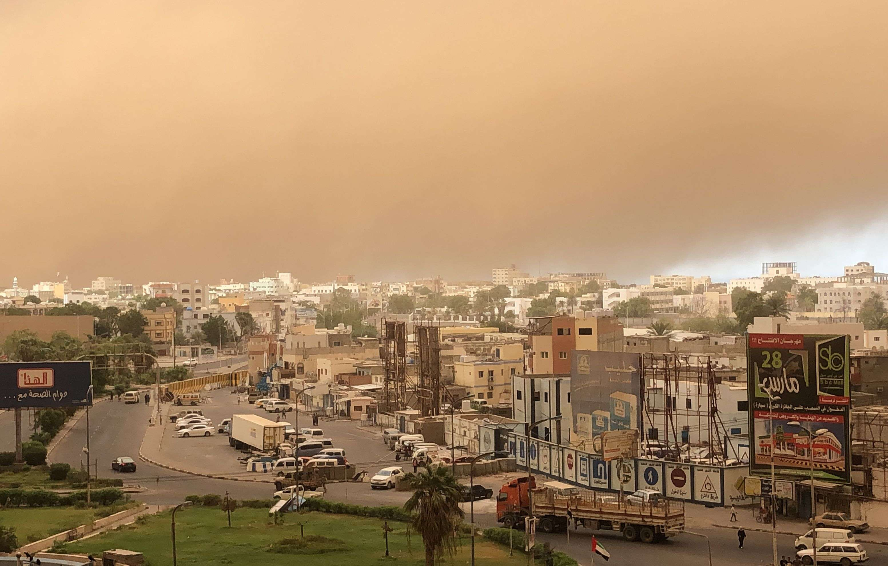 A sand storm approaches Yemen's second city of Aden on September 11, 2019. (AFP)