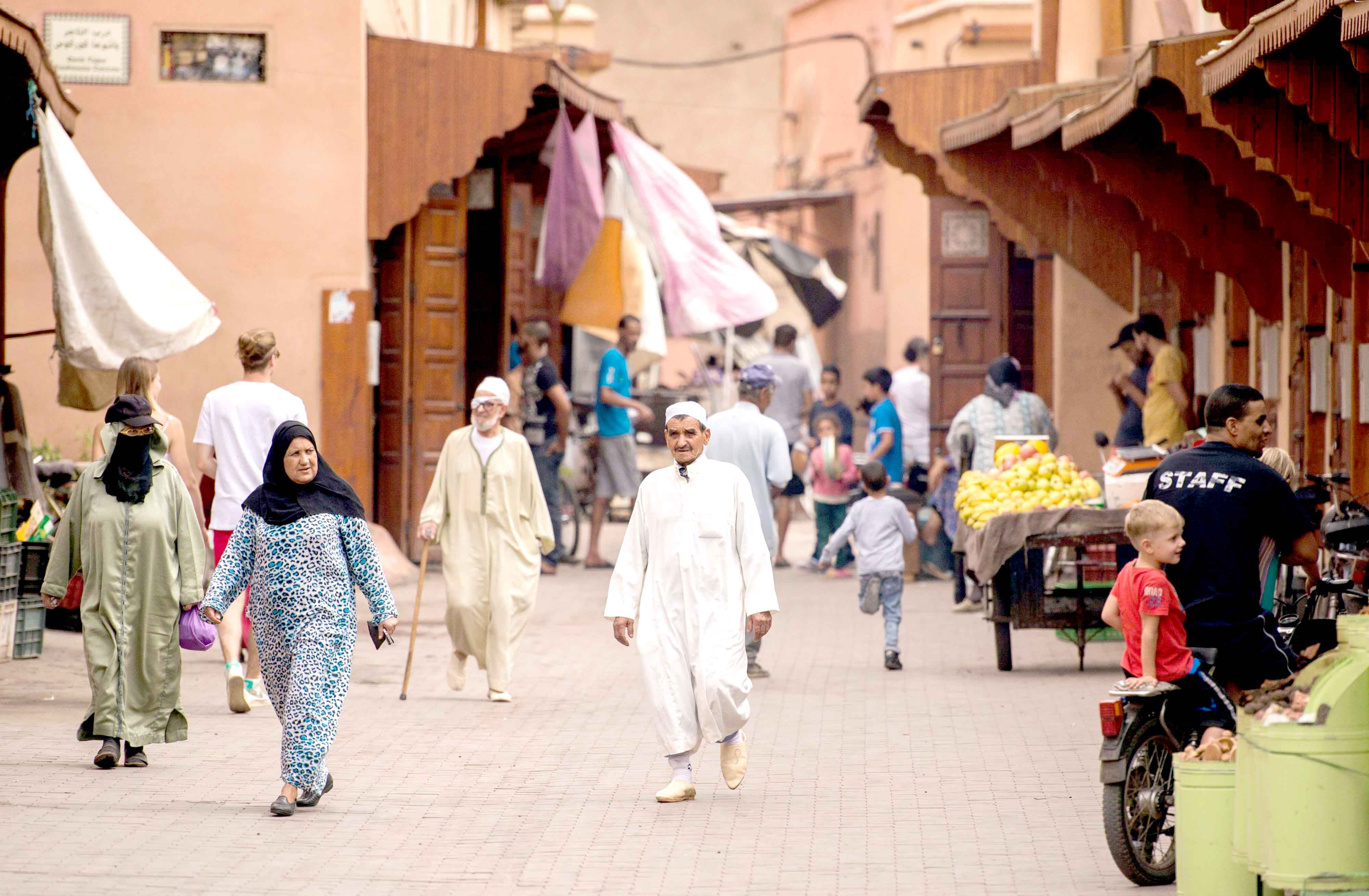 Eager for investments. People walk  along a street in the old medina of Marrakech.(AFP)