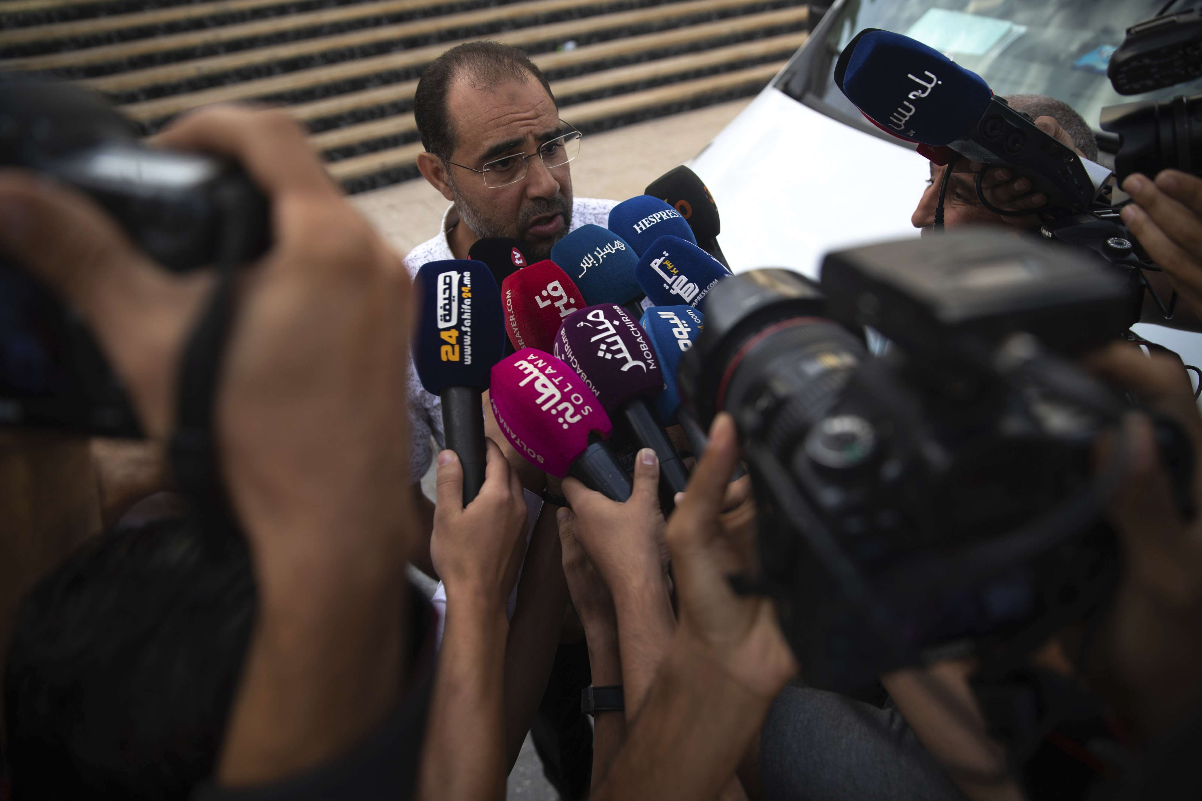 Suleyman Rissouni, uncle of journalist Hajar Rissouni and editor in chief of Akhbar Al-Youm daily newspaper, speaks to the media in Rabat, Morocco, Monday, Sept. 30, 2019. (AP)