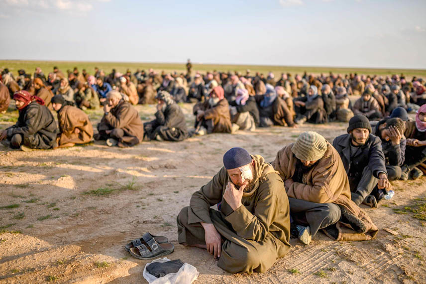 Far from defeated. Men suspected of being ISIS fighters wait to be searched by members of the  Kurdish-led Syrian Democratic Forces after leaving Baghouz in northern Syria, last February. (AFP)