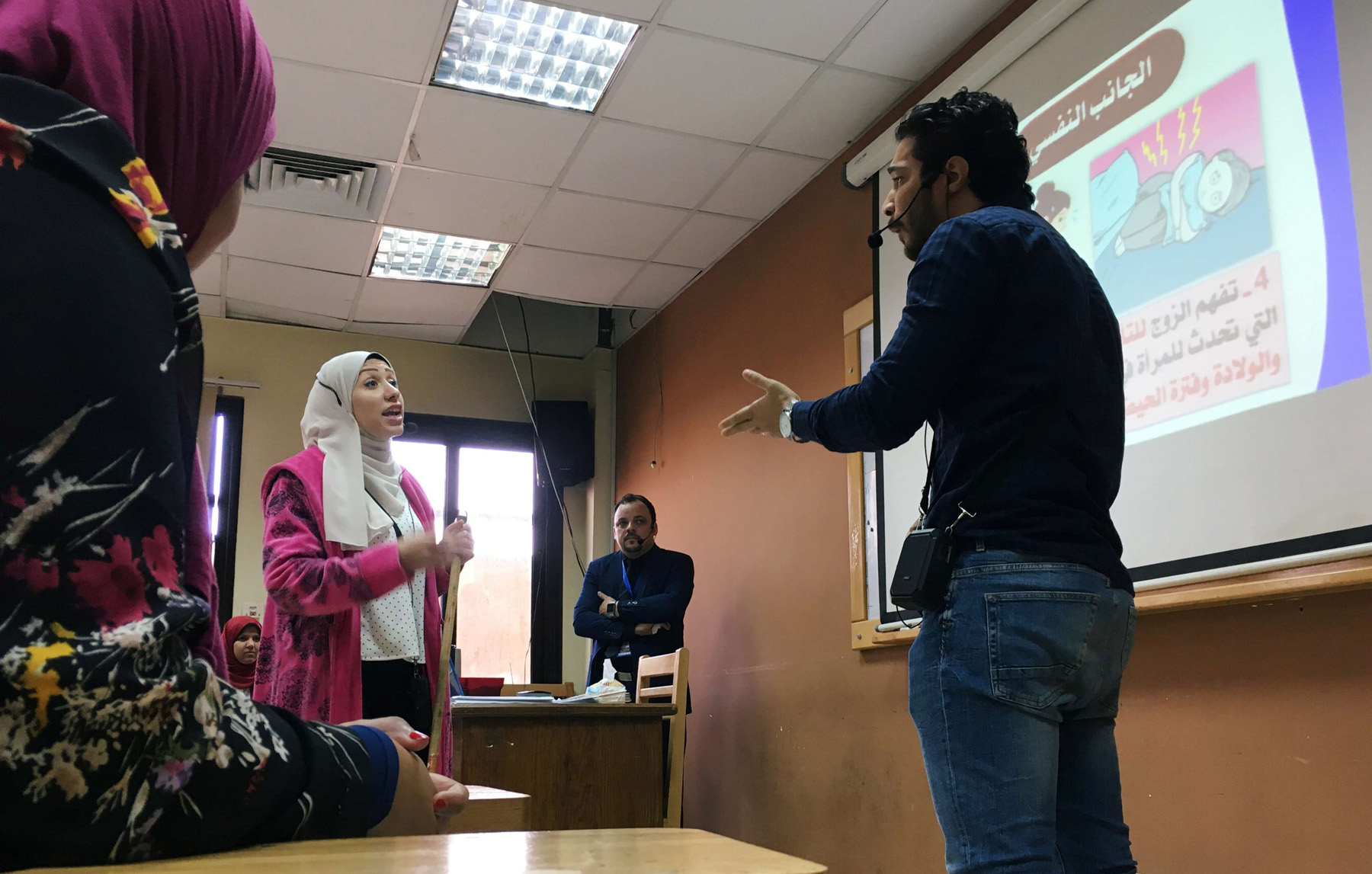Two students perform a skit at Cairo University about a married couple having an argument as part of a new government project aimed at curbing Egypt's divorce rate. (Reuters)