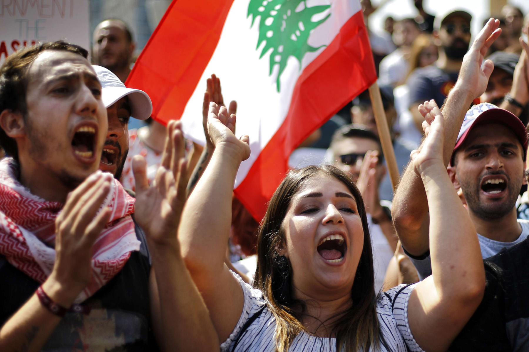 Toxic system. Anti-government protesters chant slogans during a demonstration in front of the government house in downtown Beirut, September 29.  (AP)