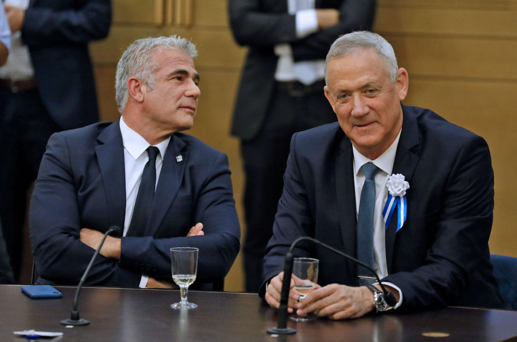 Members of Knesset Yair Lapid (L) of Yesh Atid and Benny Gantz of the Israel Resilience party, both part of the Blue and White alliance, sit together during a meeting in Jerusalem, October 3. (AFP)