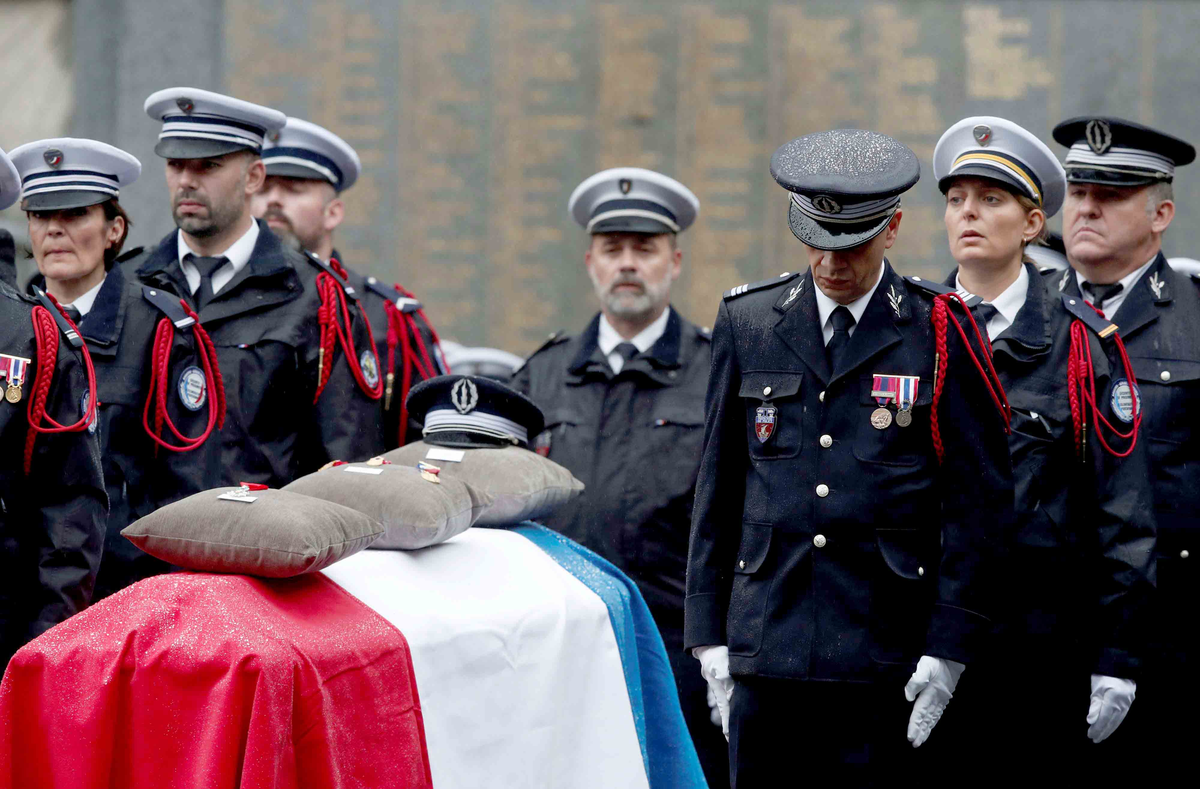 A turning point. French Police officers attend a ceremony to honour three police officers and an administrative worker killed by a suspected radicalised attacker, at the Police Prefecture in Paris, October 8.(Reuters)