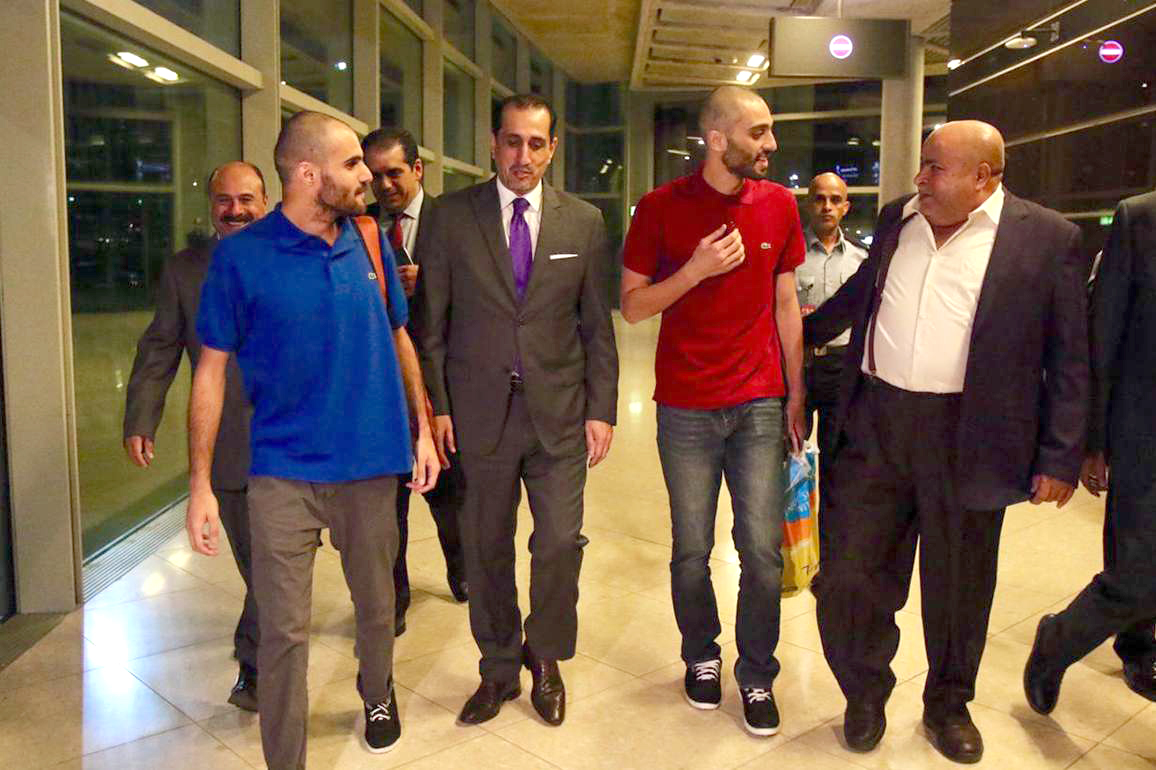 Jordanian citizens Abdel Rahman Ali Hussein and Thaer Matar, who were detained during the September rare anti-government protests, arrive at Queen Alia International Airport after being released by Egyptian authorities. (DPA)