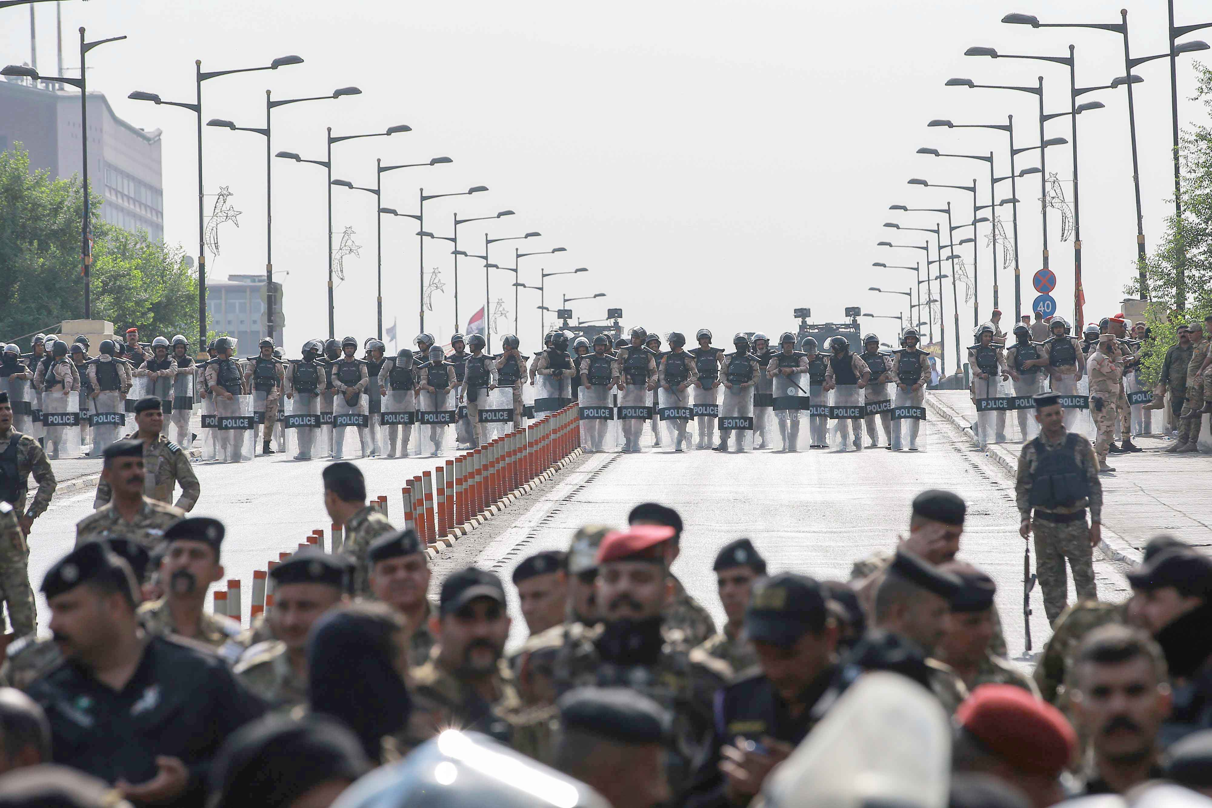 Security fortress. Iraqi security forces block a road during an anti-government demonstration against alleged government corruption in Tahrir Square in central Baghdad, October 1.(DPA)