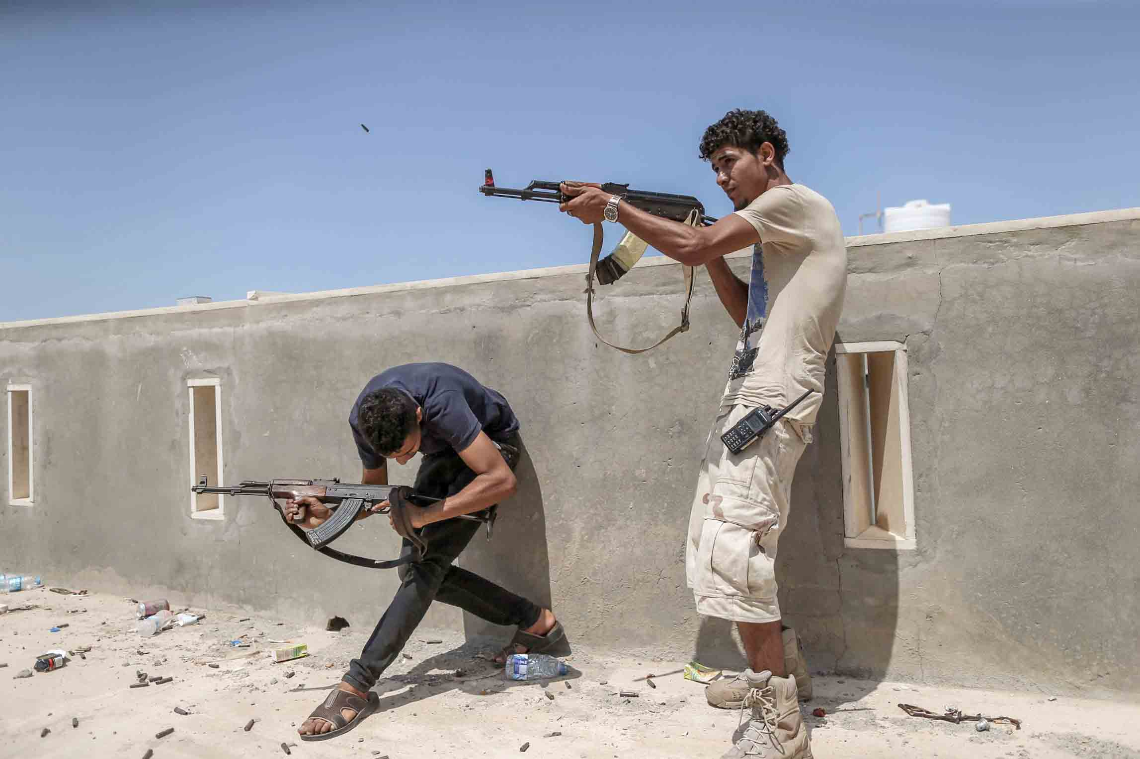 Deadlock. Fighters loyal to the Government of National Accord fire their rifles during clashes with forces of the Libyan National Army at Al-Khalla front line in Tripoli. (DPA)