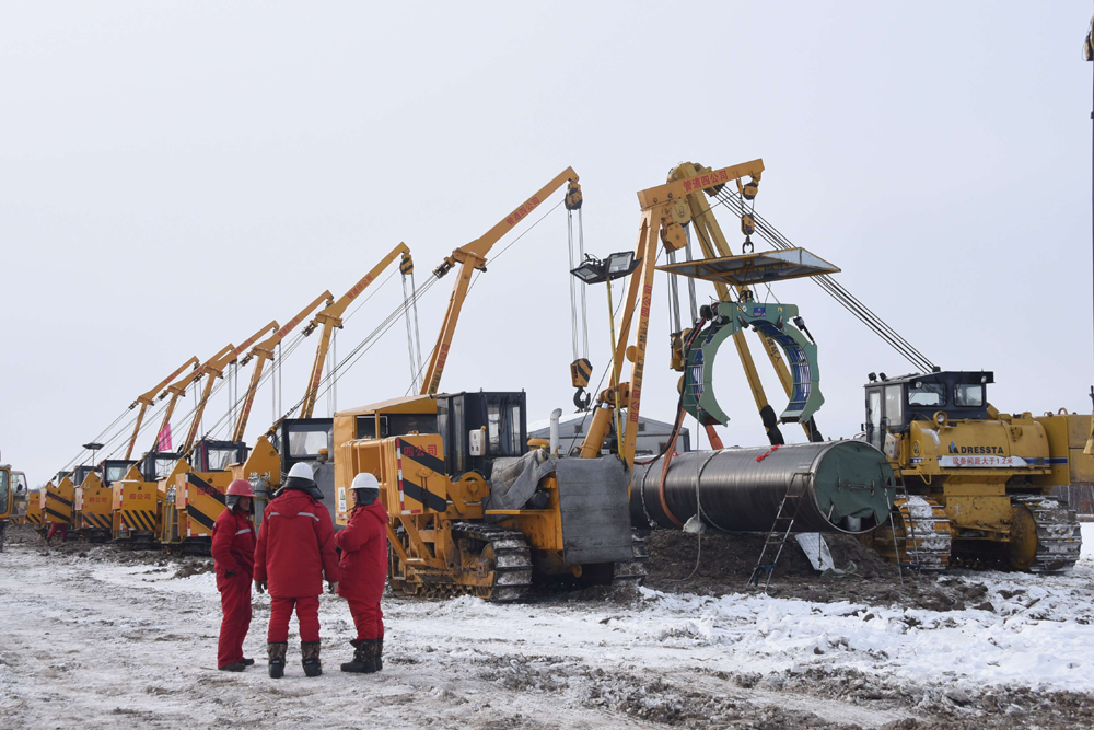 Workers of China National Petroleum Corporation (CNPC) are seen at a construction site in Heilongjiang province, China, last year. (China Daily via Reuters)