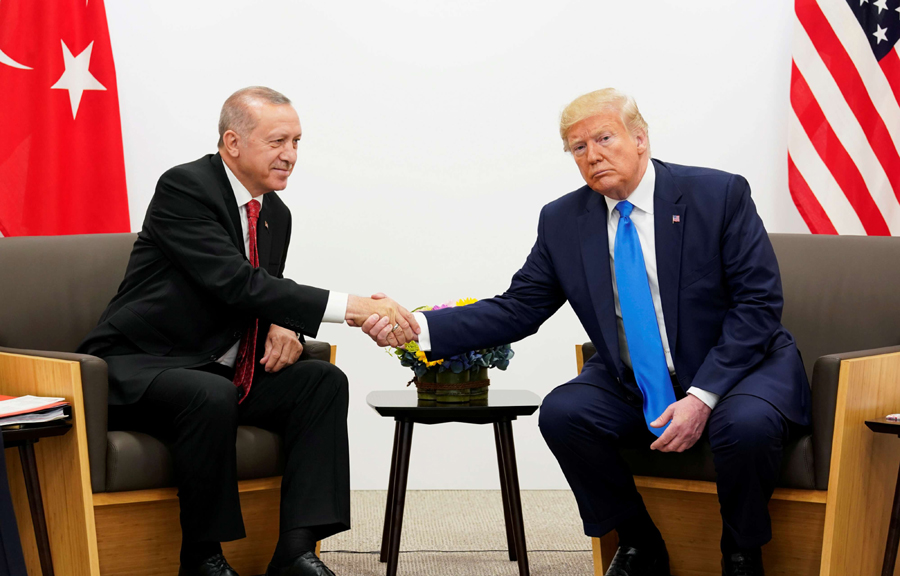 US President Donald Trump shakes hands with Turkey's President Tayyip Erdogan during a bilateral meeting at the G20 leaders' summit in Osaka, Japan, June 29. (Reuters)