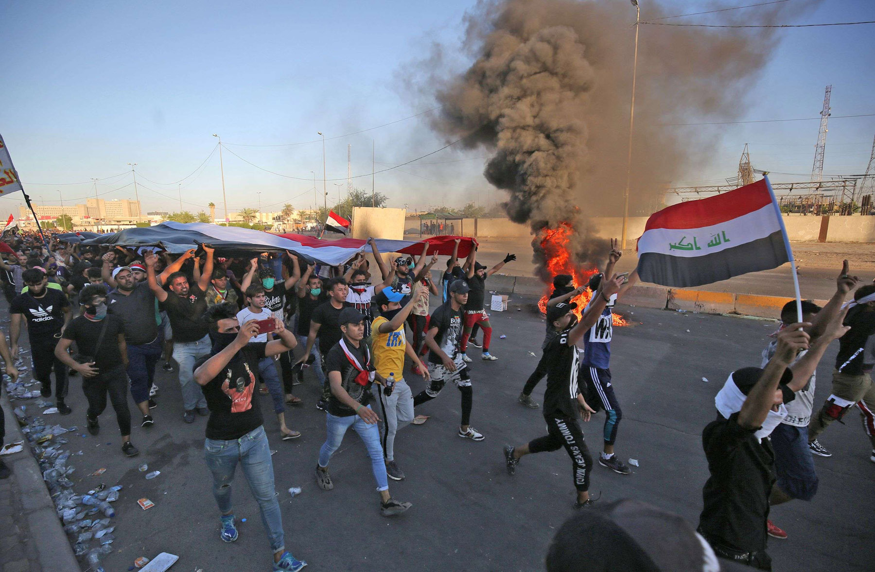 Iraqi protesters take part in a demonstration against state corruption, failing public services, and unemployment, in the Iraqi capital Baghdad's central Khellani Square on October 4. (AFP)