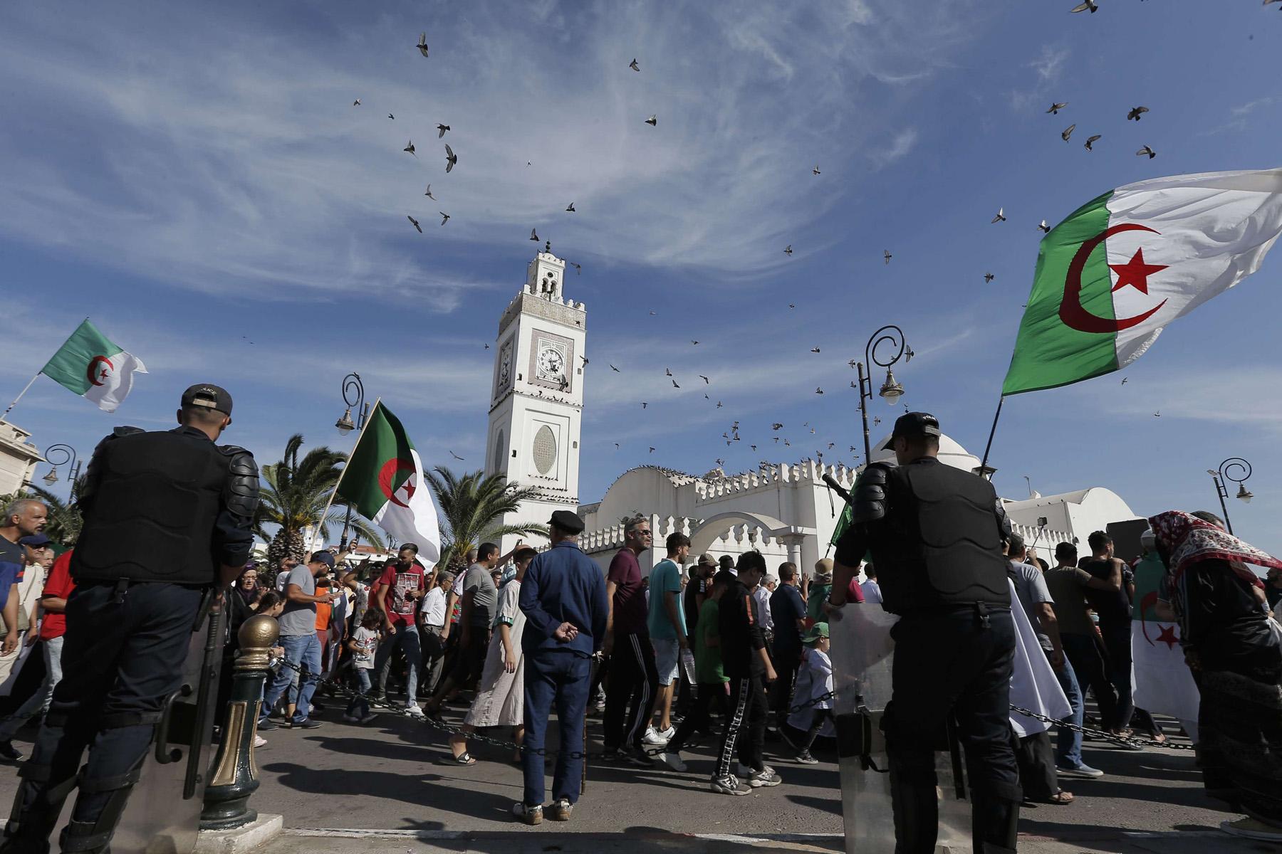 Algerians take part in a protest against the government in Algiers, Algeria, Friday, October 18. (AP)