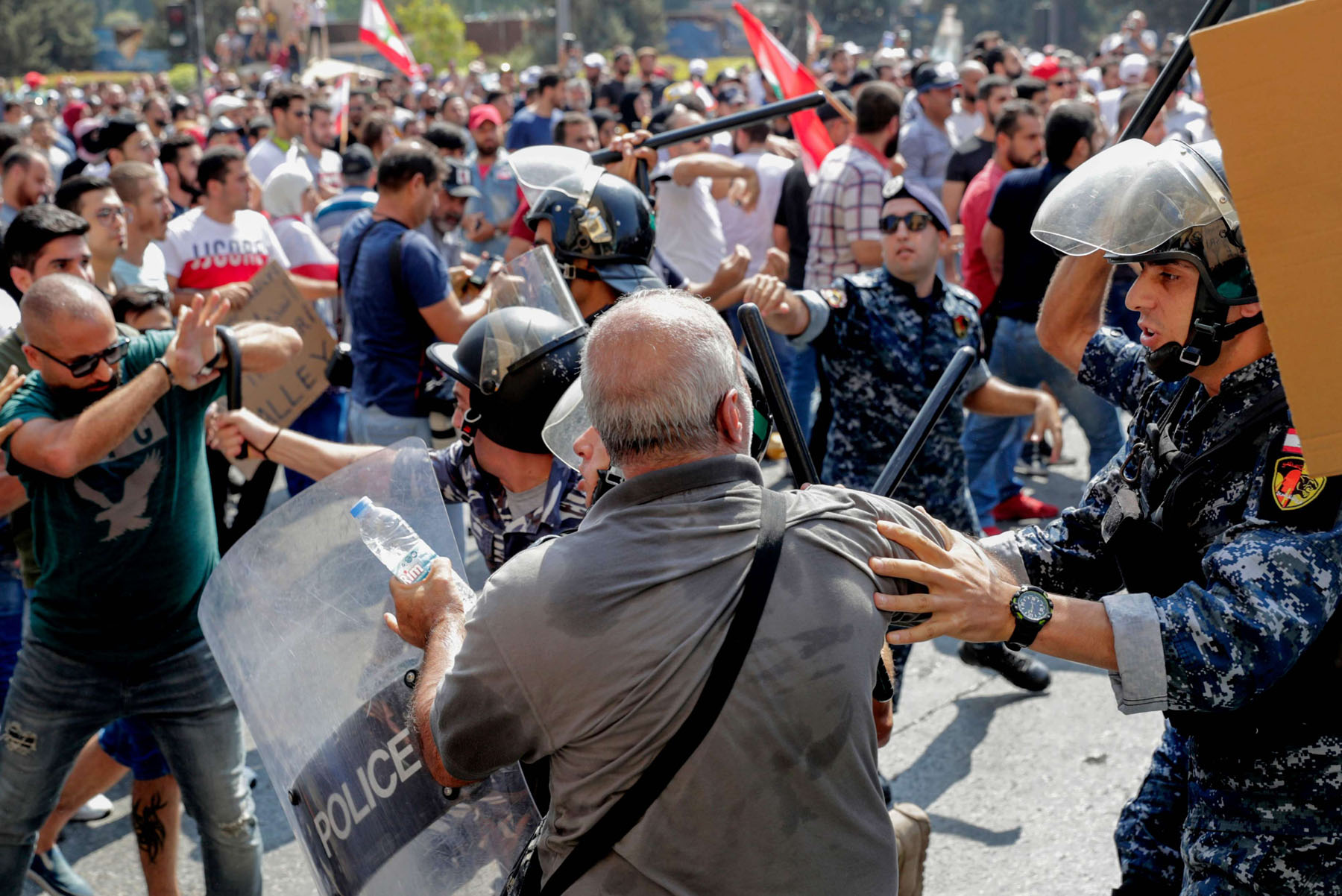 Challenges and frustrations. Lebanese protesters clash with riot policemen as they try to break through security barriers in front of the cabinet office in central Beirut's Martyr Square, September 29. (AFP)