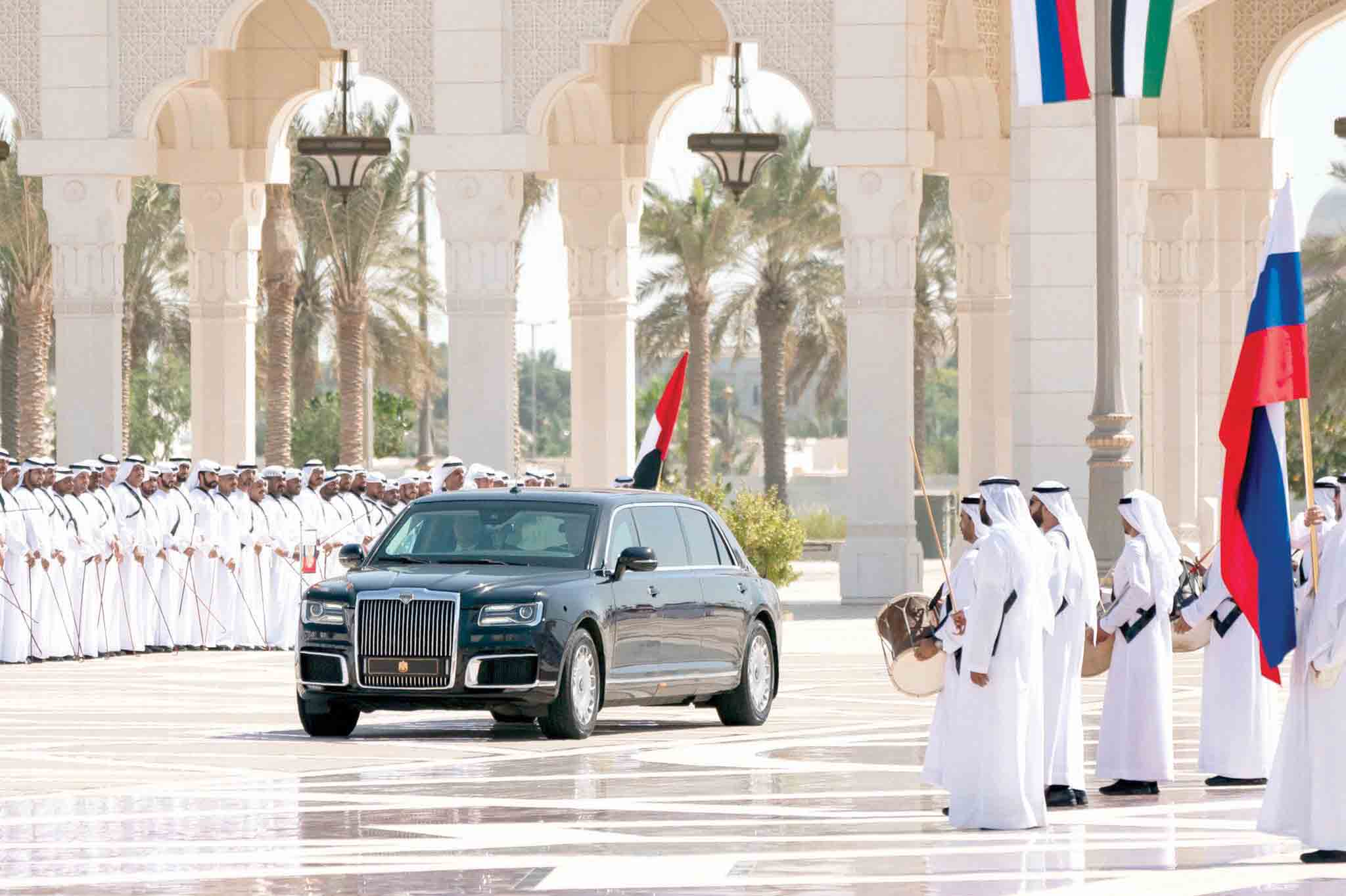 Warm welcome. Russian President Vladimir Putin arrives in a car at Qasr Al Watan in Abu Dhabi, October 15. (WAM)