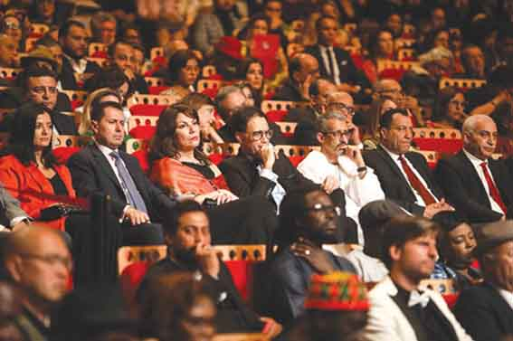 Tunisian Culture Minister Mohamed Zine el-Abidine (C) attends the opening ceremony of the Carthage Film Festival in Tunis. (JCC)