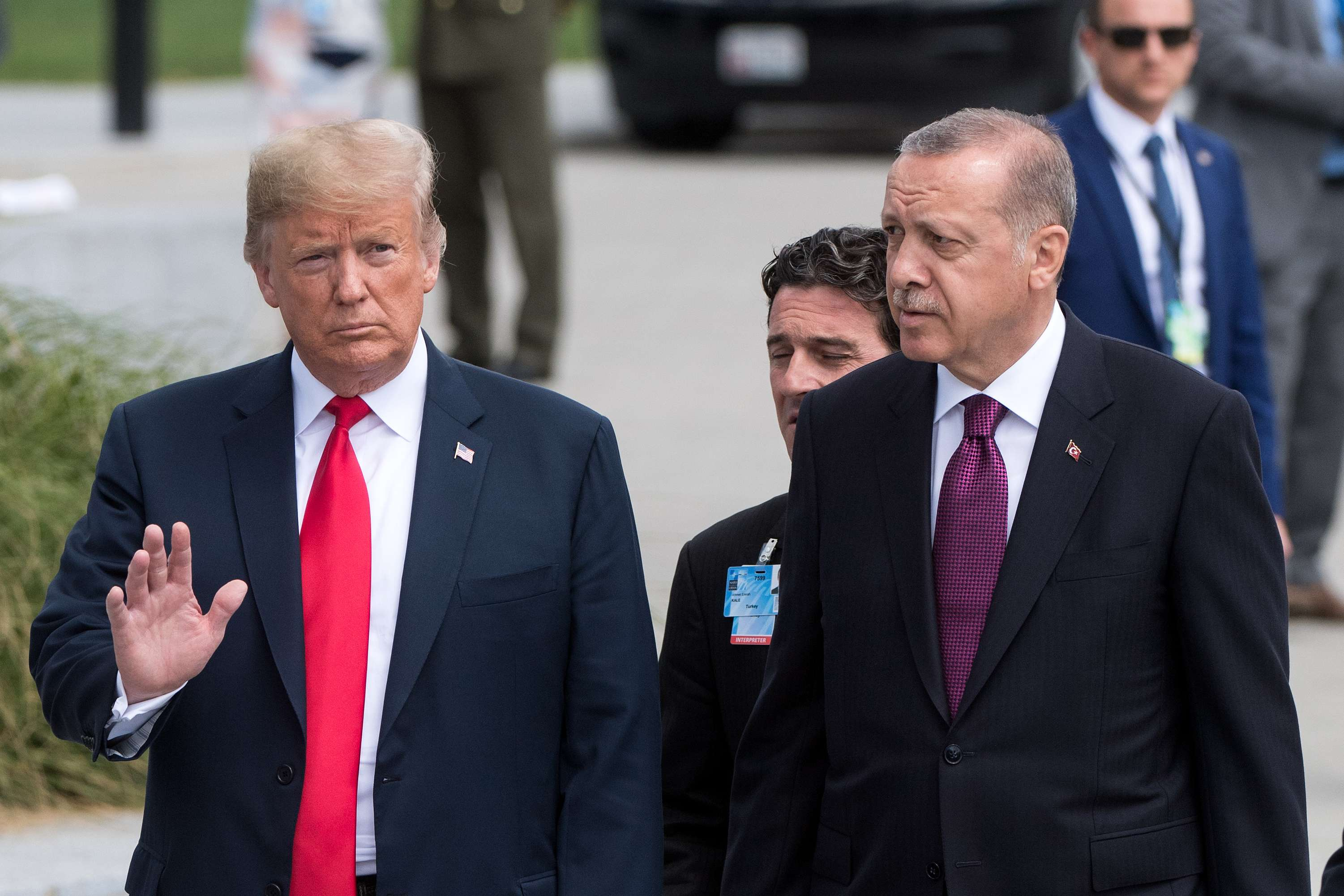 11 July 2018, Belgium, Brussels: US President Donald Trump (L) and Turkish President Recep Tayyip Erdogan arrive at a photocall during the NATO Summit. (DPA)