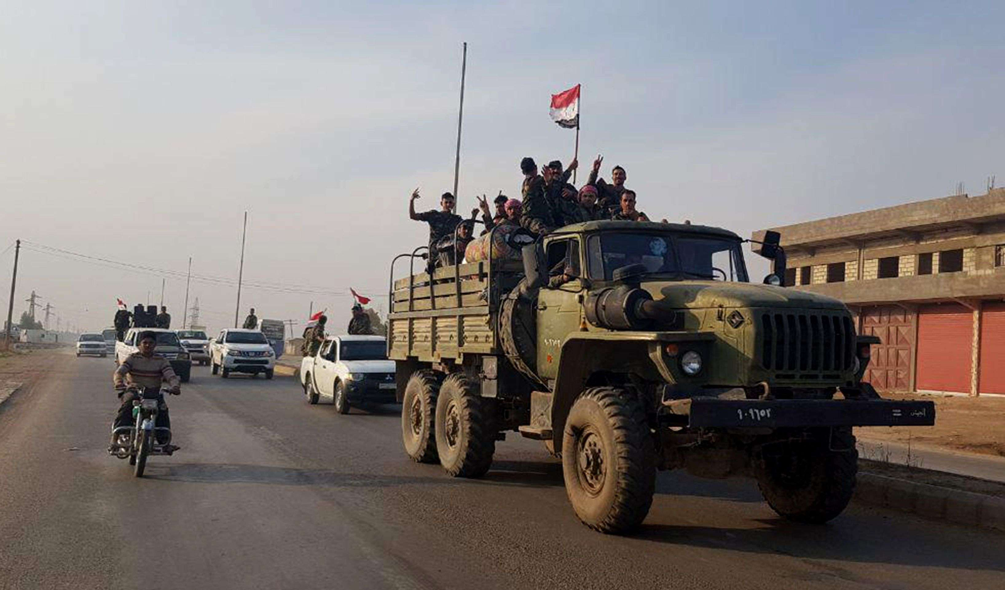 Syrian troops deploying in an area in the northeastern Syrian Hasakeh province on the border with Turkey, part of a deal reached with the Kurds last month, November 14, 2019. (AFP)