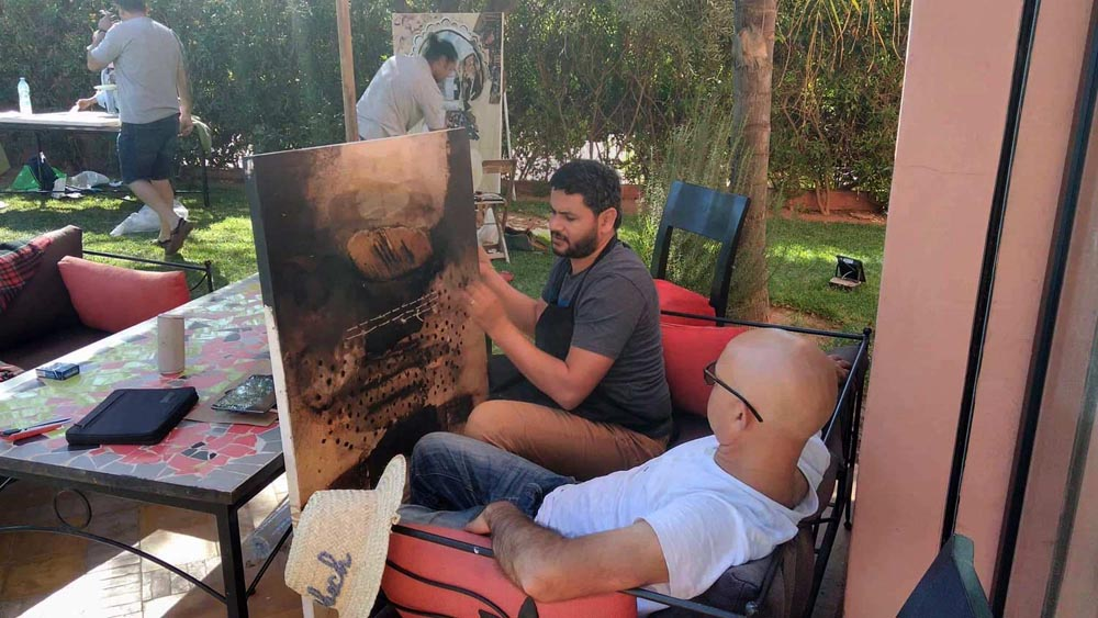"Artists take part in the ""Art and Friendship Salon"" in Marrakech.      (Al Arab)"