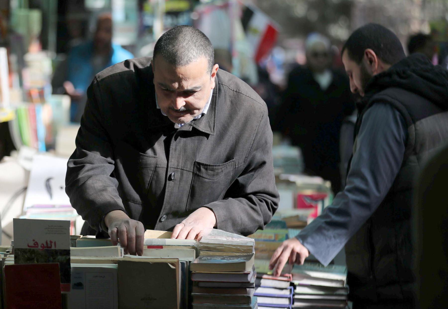 A man chooses a book at Al-Azbakeya market in Cairo.        (Reuters)