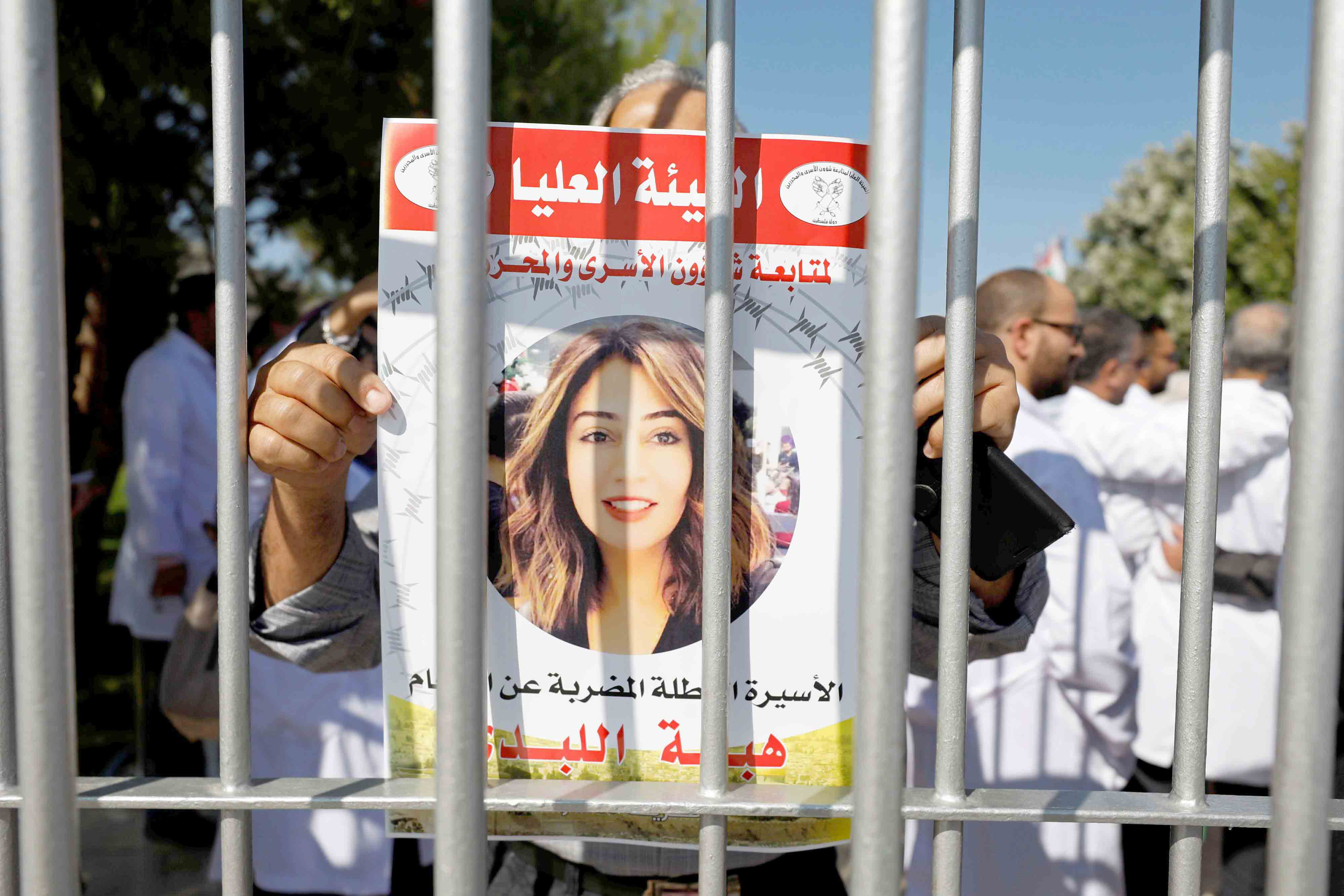 A demonstrator holds a picture of Jordanian citizen Hiba al-Labadi during a protest in Ramallah in the Israeli-occupied West Bank, October 31. (Reuters)