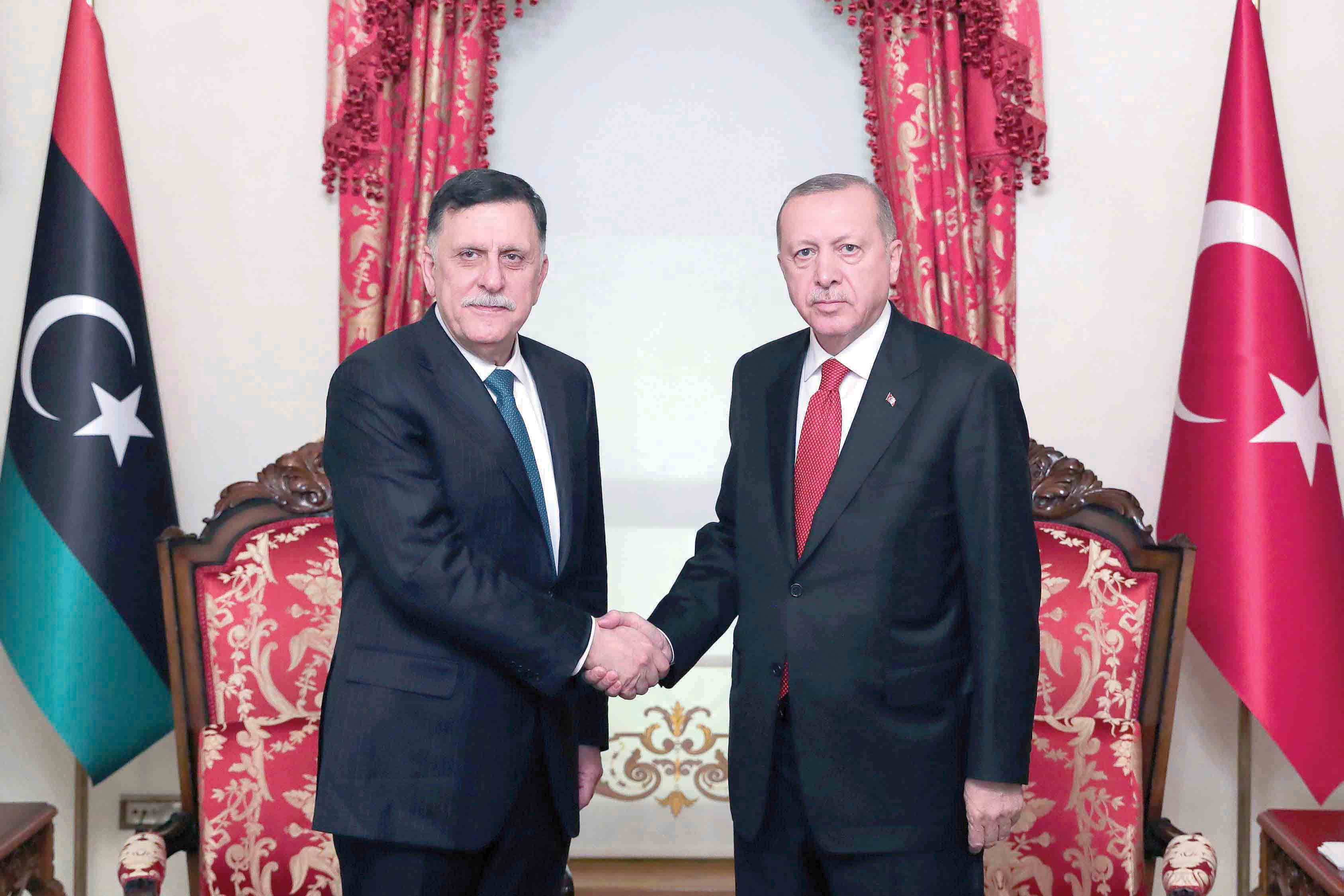 Unpredictable consequences. Turkish President Recep Tayyip Erdogan (R)  and the head of the Tripoli-based Government of National Accord Fayez al-Sarraj during their meeting in Istanbul, November 27. (AFP)