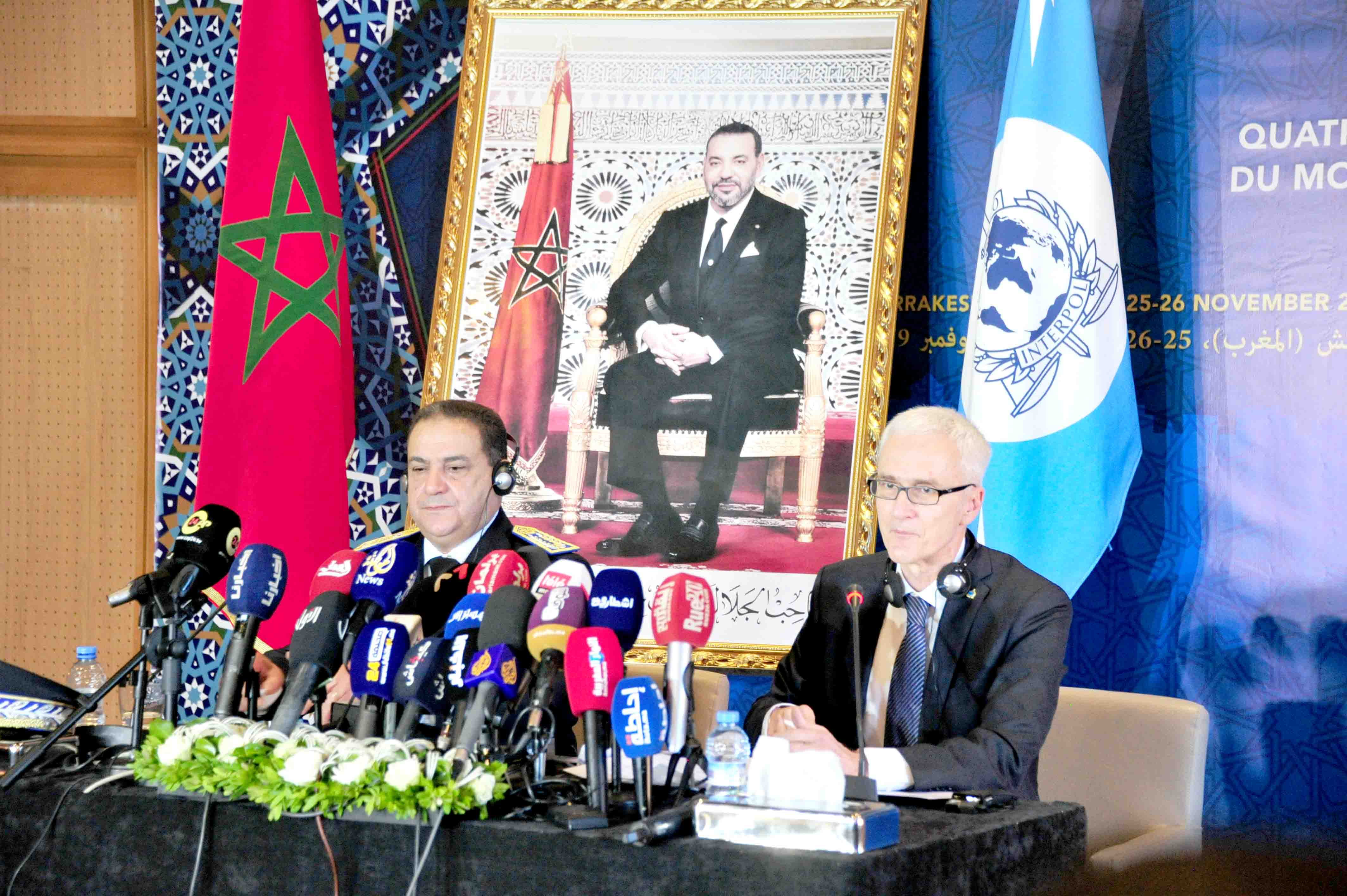 Expert views. Interpol Secretary-General Jurgen Stock (R) and Mohammed Dkhissi, head of Morocco's judicial police, speak during the opening of the fourth meeting for Chiefs of Police from the Middle East and North Africa, November 25.(Saad Guerraoui)