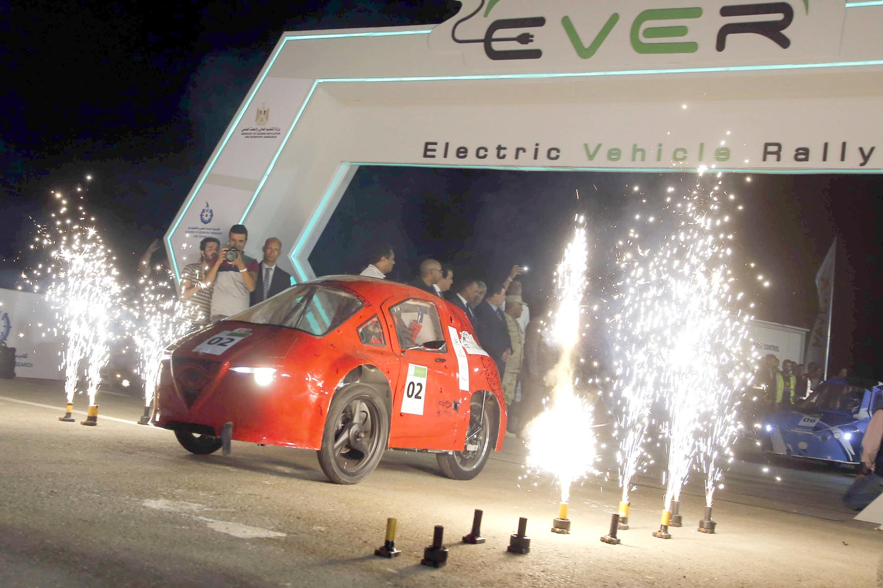 Fireworks burst during the start of the electric vehicle rally in the new administrative capital, east of Cairo.  (AP)