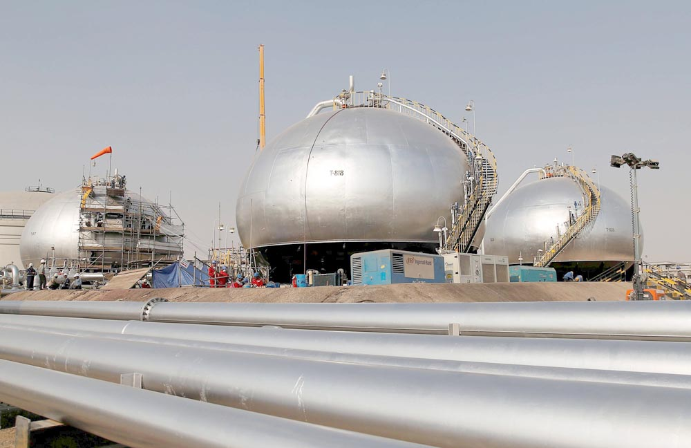 Spheroids under reconstruction at Saudi Aramco oil facility in Abqaiq, October 12.                                                          (Reuters)