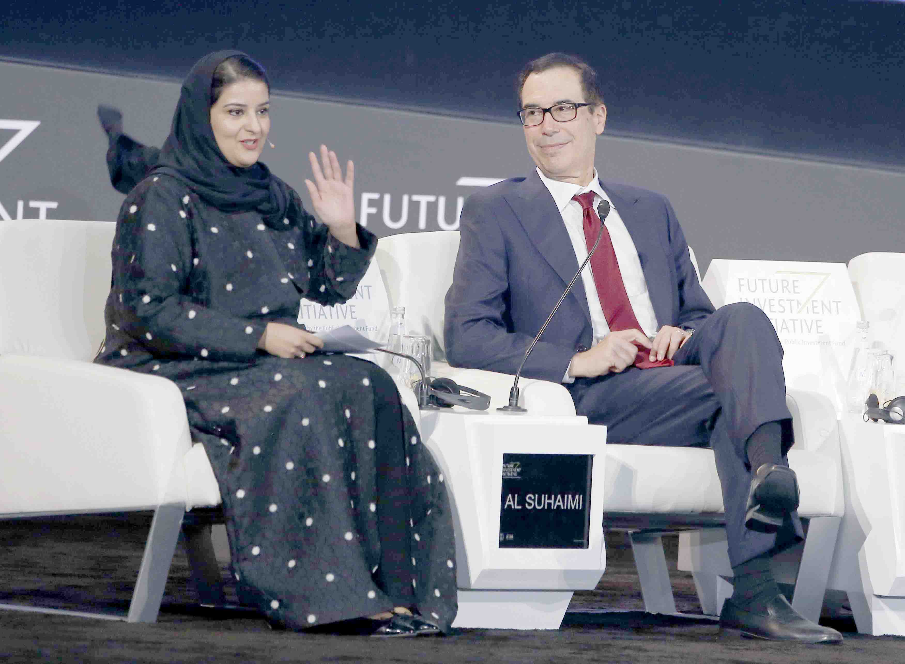 An eye on the future. Chairwoman of Saudi Arabia's stock exchange Sarah al-Suhaimi (L) speaks before an interview with US Treasury Secretary Steven Mnuchin at the Future Investment Initiative forum in Riyadh, October 30.(AP)
