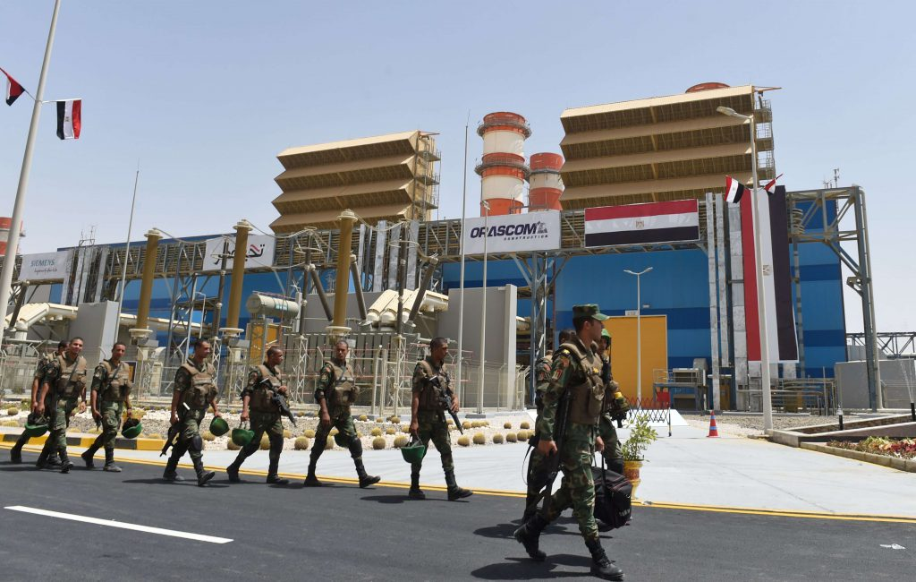 Egyptian soldiers walk in front of a newly-constructed combined-cycle power stations on the outskirts of Cairo. (AFP)