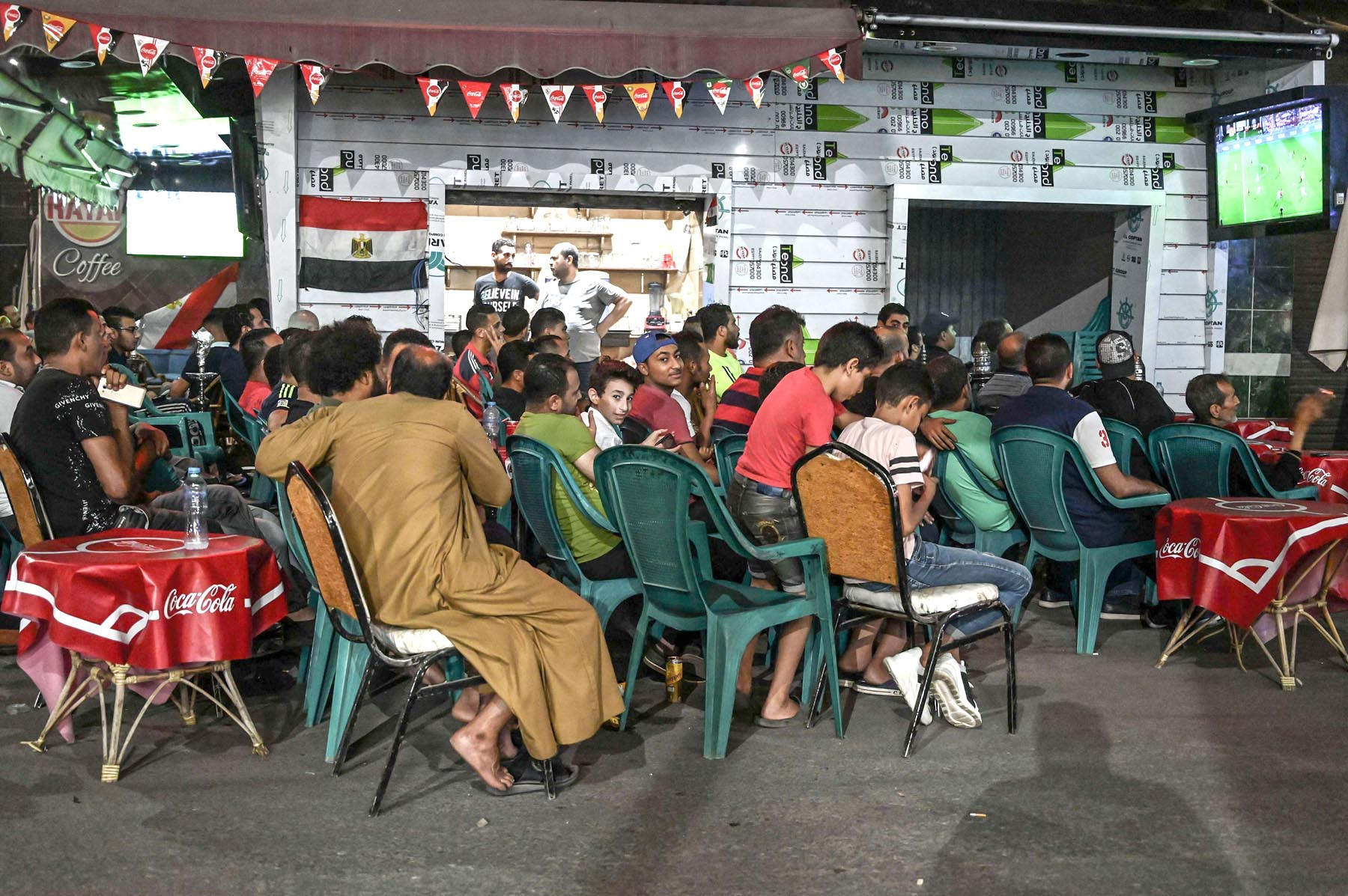 Egyptians gather at a cafe in the city of Ismailia to watch a 2019 Africa Cup of Nations football match, last June. (AFP)
